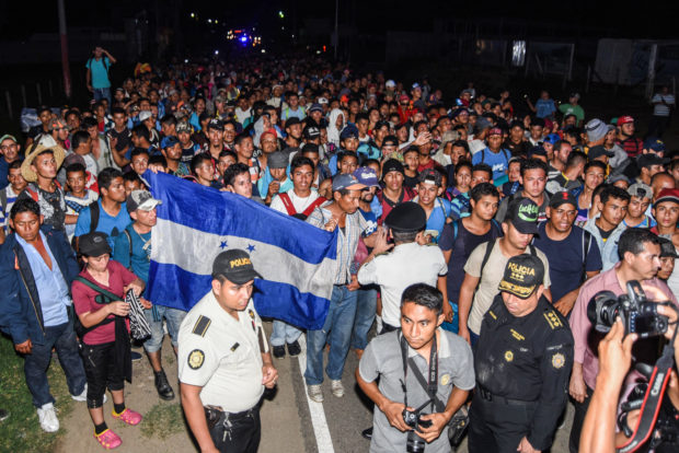 TOPSHOT - Honduran migrants taking part in a new caravan heading to the US, arrive to Chiquimula, Guatemala, on October 22, 2018. - US President Donald Trump on Monday called the migrant caravan heading toward the US-Mexico border a national emergency, saying he has alerted the US border patrol and military. (Photo by ORLANDO ESTRADA / AFP) (Photo credit should read ORLANDO ESTRADA/AFP/Getty Images)