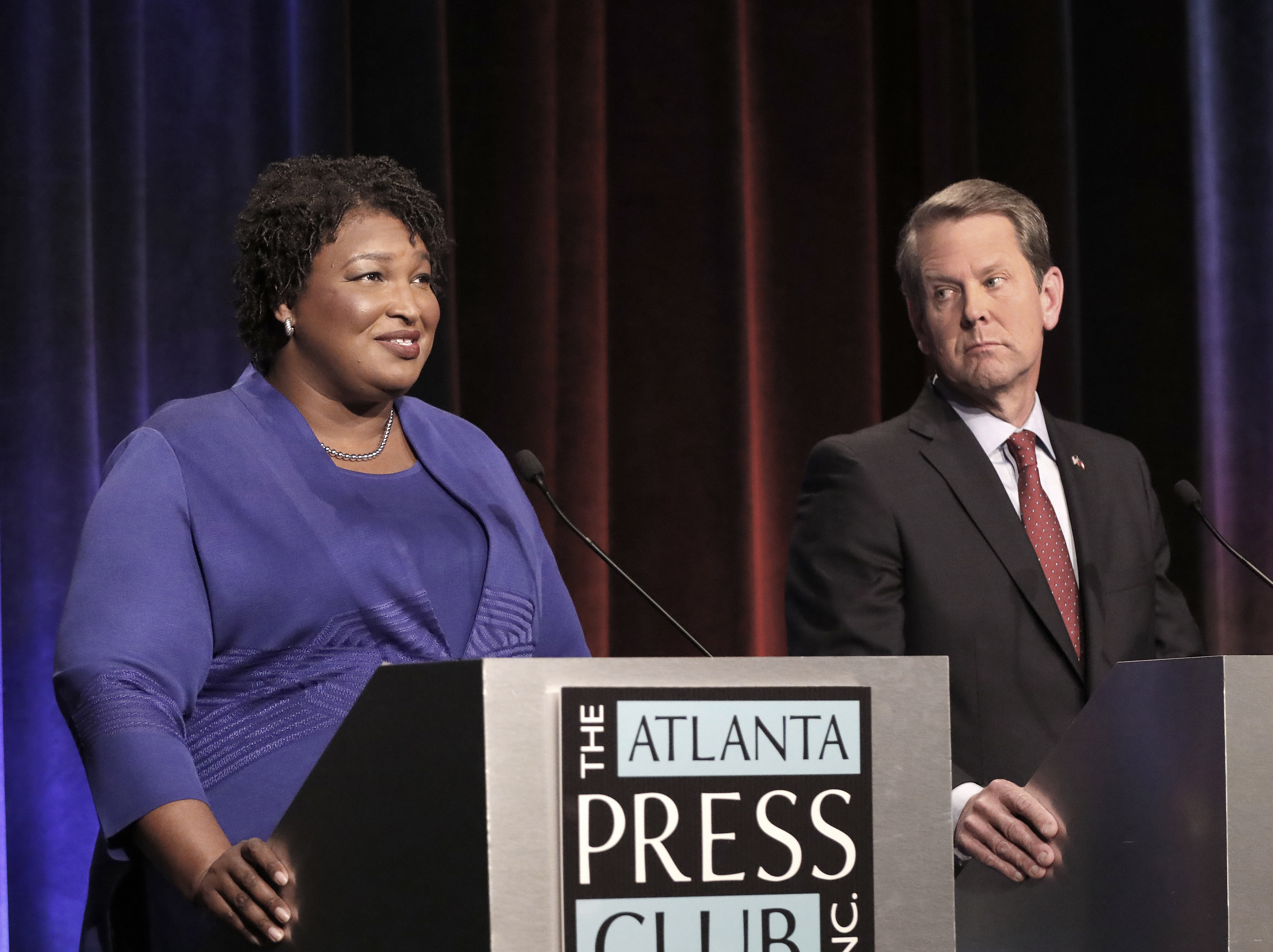 Georgia gubernatorial candidates Democrat Stacey Abrams and Republican Brian Kemp debate in an event that also included Libertarian Ted Metz at Georgia Public Broadcasting in Midtown October 23, 2018 in Atlanta, Georgia. John Bazemore-Pool/Getty Images