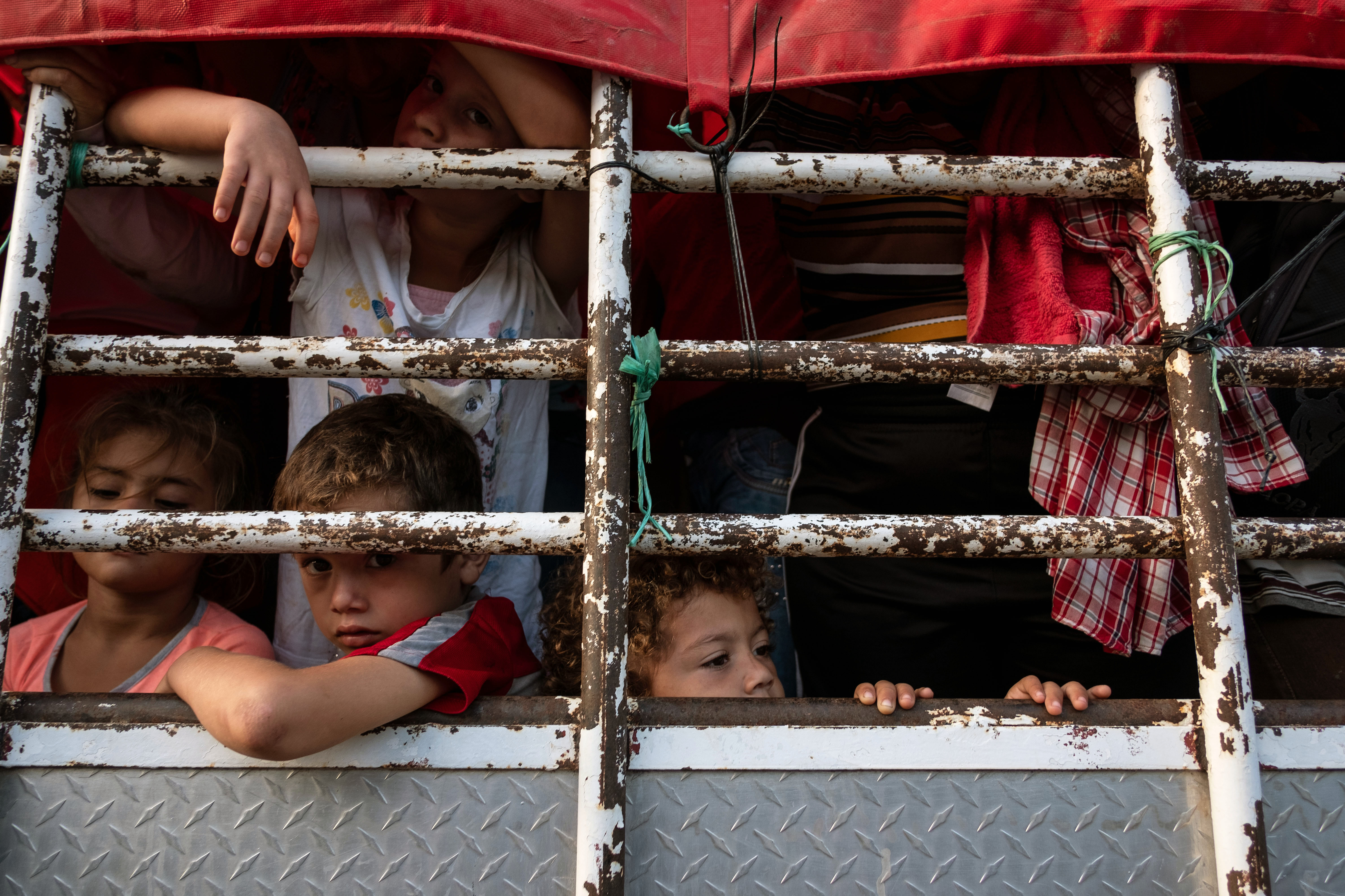 Honduran migrant children heading in a caravan to the US, travel on a truck near Pijijiapan, southern Mexico on October 26, 2018. GUILLERMO ARIAS/AFP/Getty Images