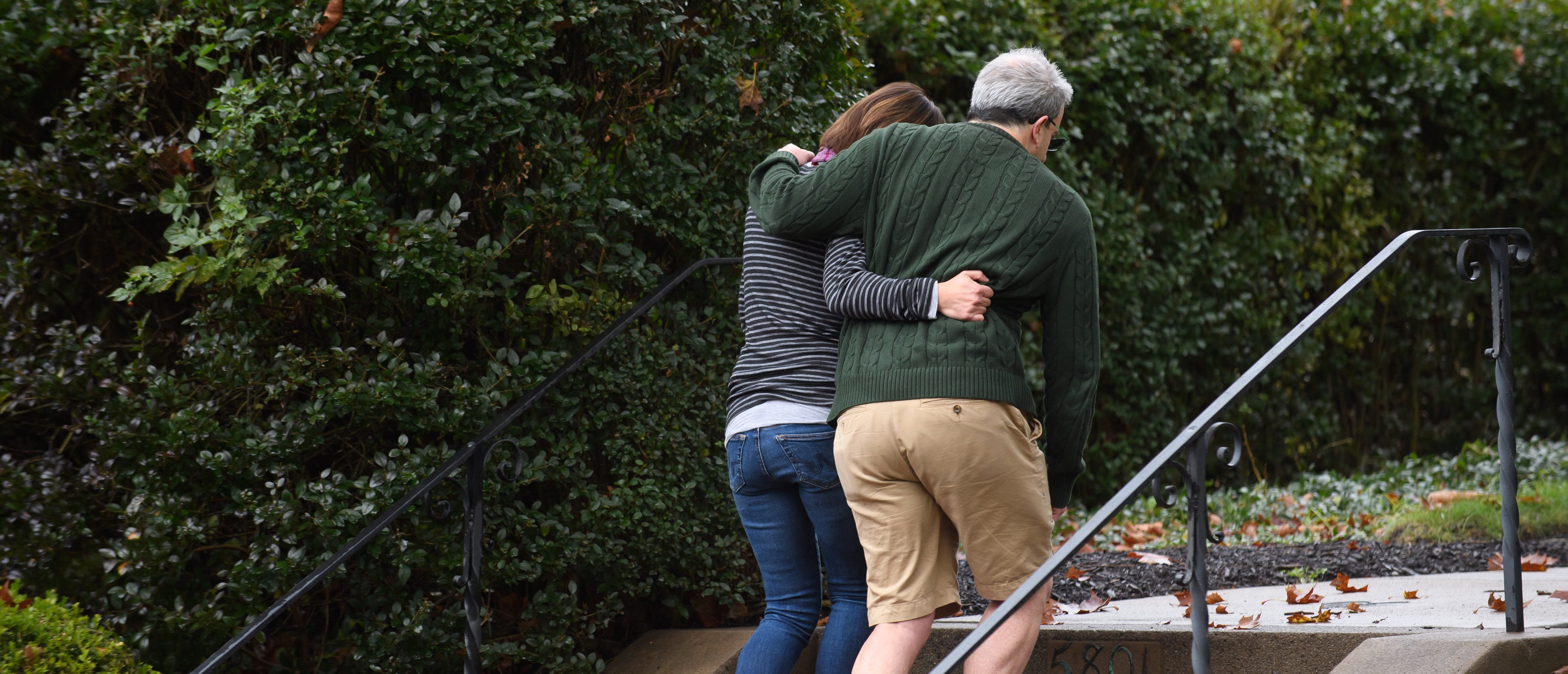 PITTSBURGH, PA - OCTOBER 27: Neighbors around the corner from the site of a mass shooting at the Tree of Life Synagogue embrace one another in the Squirrel Hill neighborhood on October 27, 2018 in Pittsburgh, Pennsylvania. According to reports at least 12 people were shot, 4 dead and three police officers hurt during the incident. The shooter surrendered to authorities and was taken into custody. (Photo by Jeff Swensen/Getty Images)