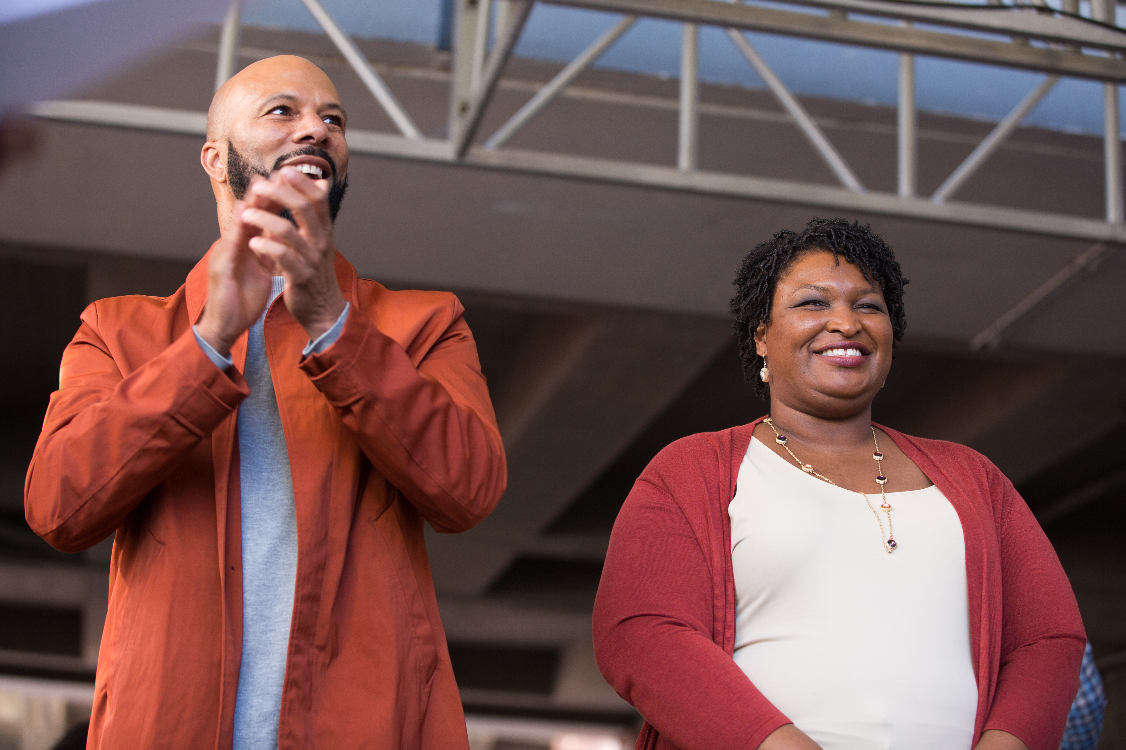 "Democratic Georgia Gubernatorial candidate Stacey Abrams and Grammy-winning artist Common stand in front of a crowd gathered for the ""Souls to The Polls"" march in downtown Atlanta on October 28, 2018 in Atlanta, Georgia. Jessica McGowan/Getty Images"