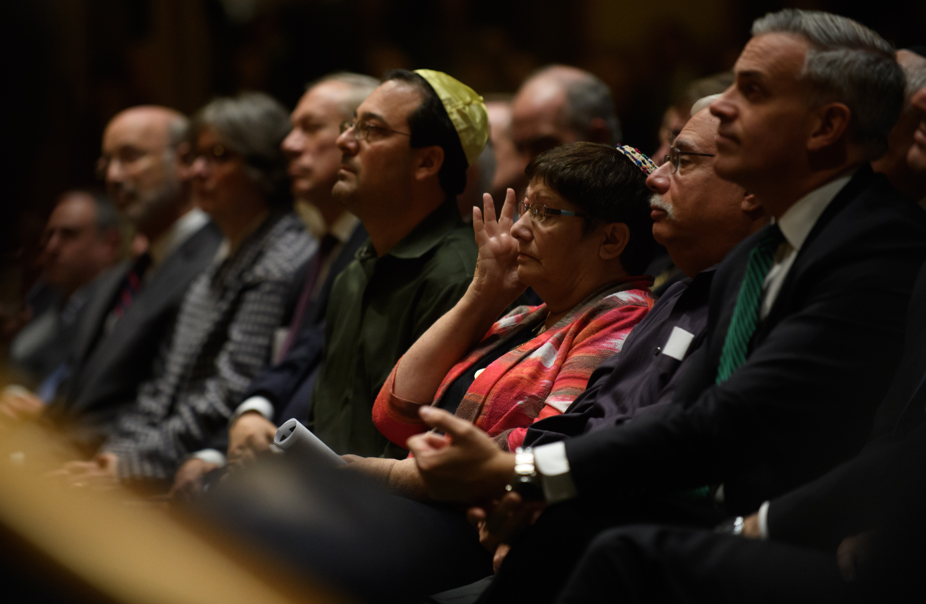 People listen to interfaith speakers at the Soldiers and Sailors Memorial Hall before a service to honor and mourn the victims of Saturday's mass shooting at the Tree Of Life Synagogue on October 28, 2018 in Pittsburgh, Pennsylvania. Jeff Swensen/Getty Images