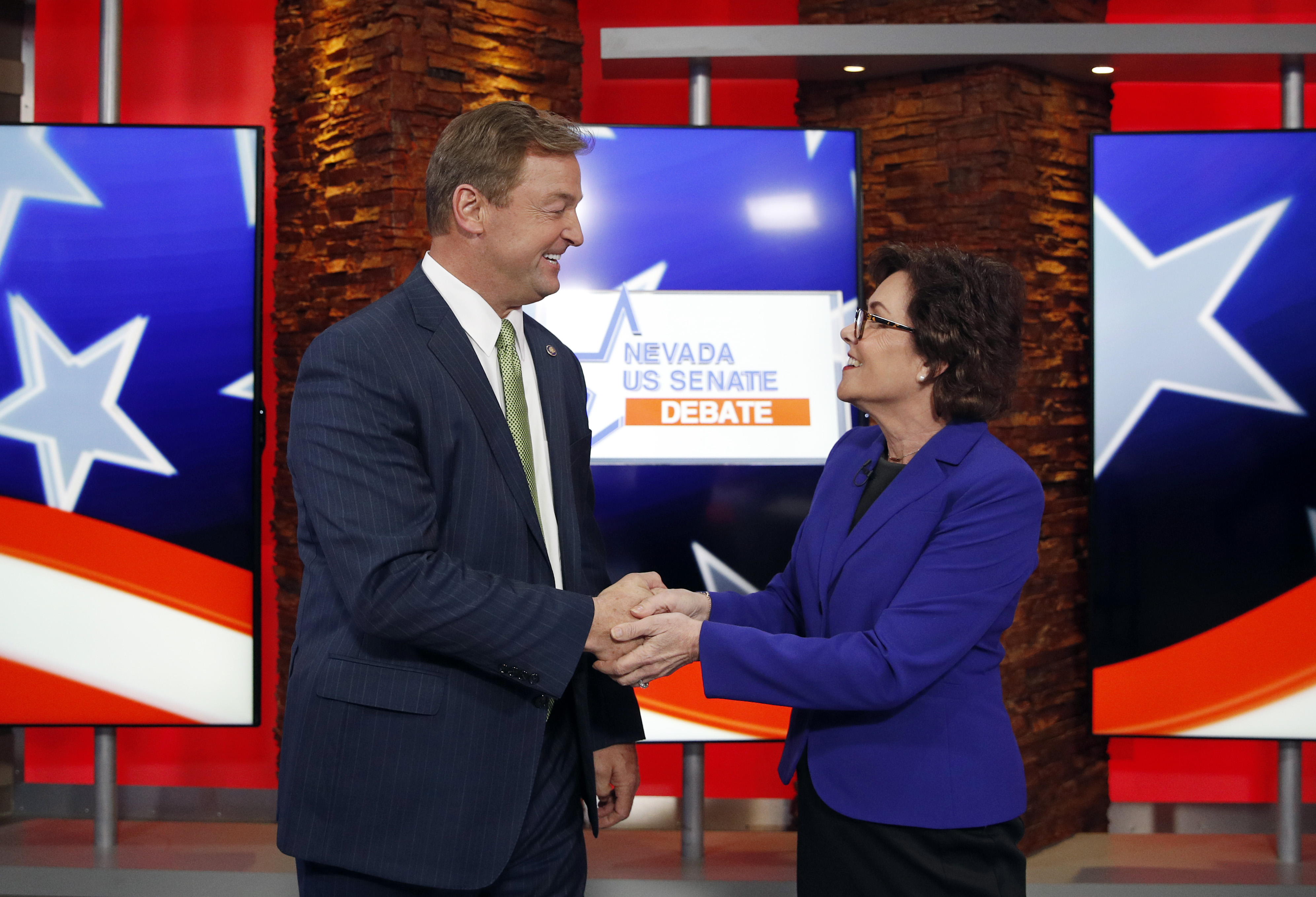 U.S. Sen. Dean Heller (R-NV) (L) and U.S. Rep Jacky Rosen (D-NV) shake hands before their debate at KLAS Channel 8 Studios on October 19, 2018 in Las Vegas, Nevada. John Locher-Pool/Getty Images