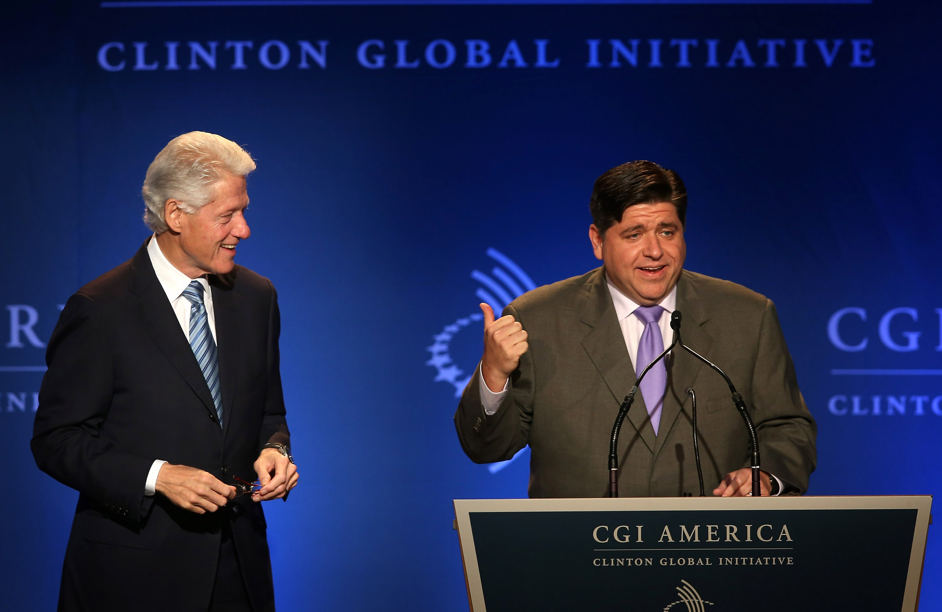 Former President Bill Clinton (L) listens as venture capitalist J.B. Pritzker speaks to guests at the Clinton Global Initiative (CGI) on June 13, 2013 in Chicago, Illinois. Scott Olson/Getty Images