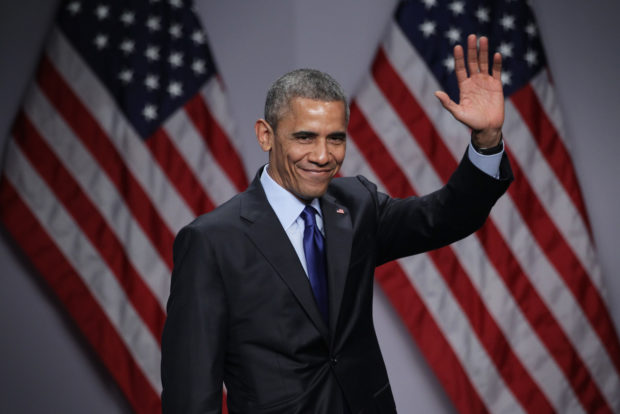 NATIONAL HARBOR, MD - MARCH 23: U.S. President Barack Obama waves after he spoke during the SelectUSA Investment Summit March 23, 2015 in National Harbor, Maryland. The summit brought together investors from around the world to showcase the diversity of investment opportunities available in the U.S. (Photo by Alex Wong/Getty Images)