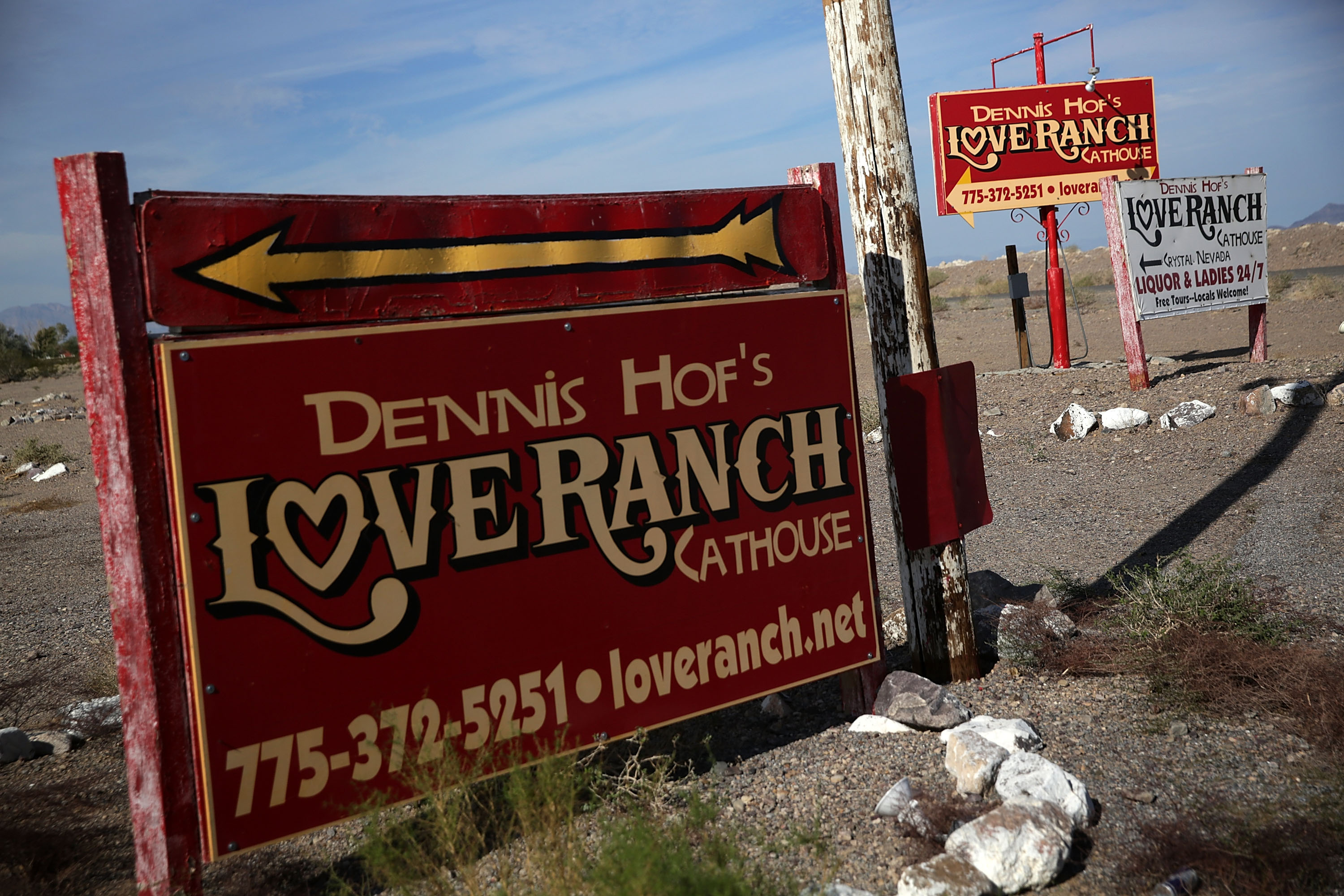 Signs for Dennis Hof's Love Ranch Las Vegas brothel are shown on October 14, 2015 in Crystal, Nevada. Alex Wong/Getty Images