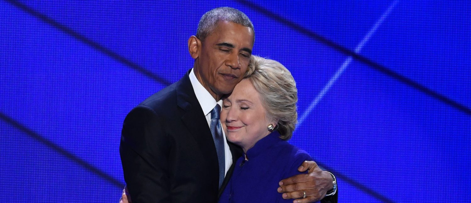 TOPSHOT - US President Barack Obama and Democratic presidential nominee Hillary Clinton embrace on stage during Day 3 of the Democratic National Convention at the Wells Fargo Center, July 27, 2016 in Philadelphia, Pennsylvania. / AFP / SAUL LOEB (Photo credit should read SAUL LOEB/AFP/Getty Images)