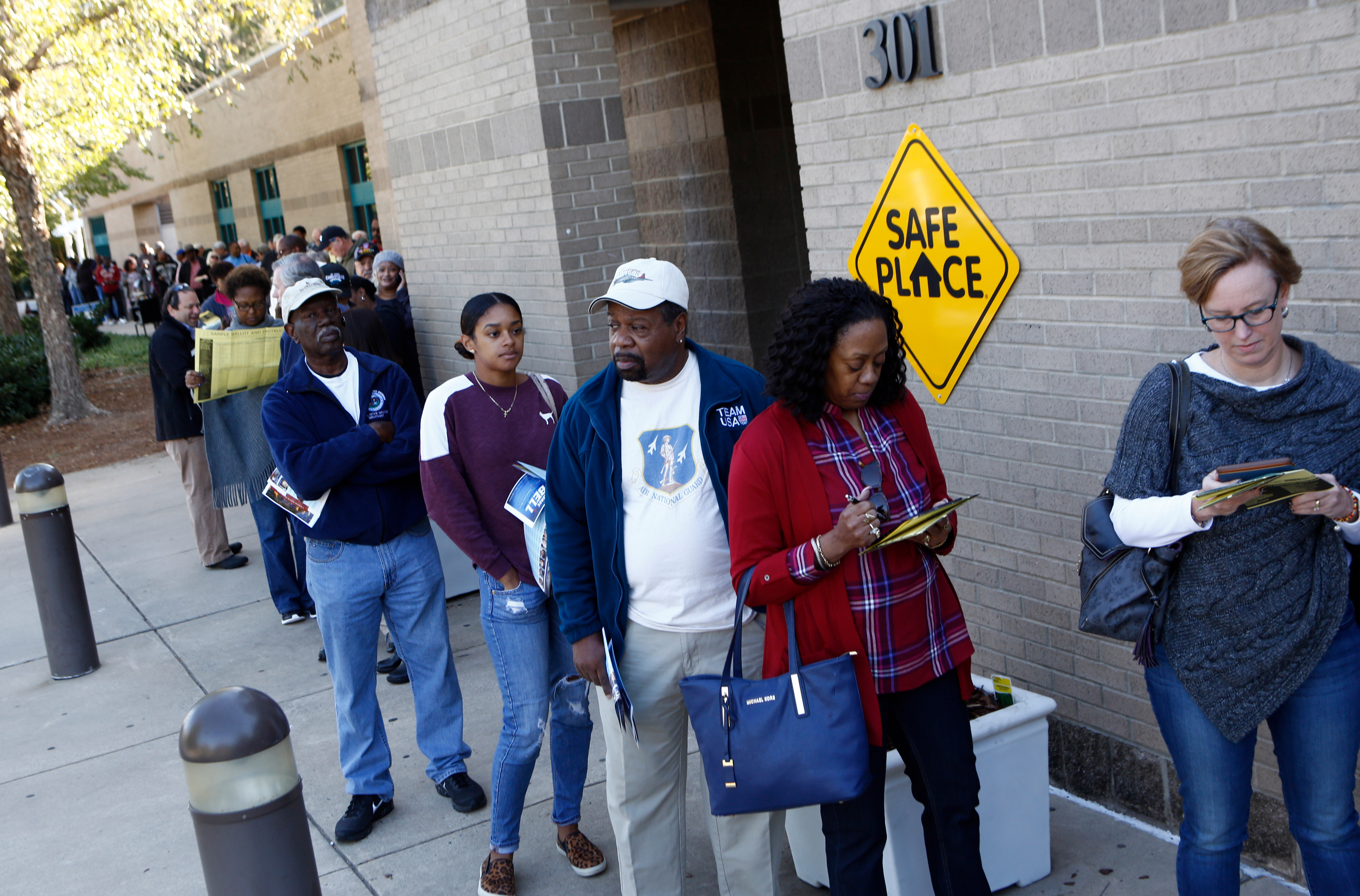 North Carolina residents wait in a line to get into the Charlotte Mecklenburg University City Library to early vote on October 24, 2016 in Charlotte, North Carolina. Brian Blanco/Getty Images