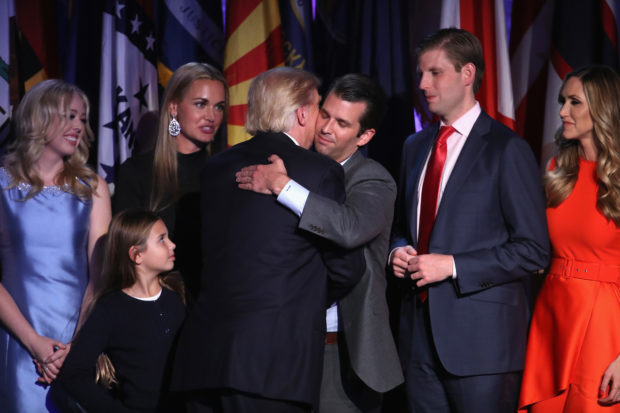 NEW YORK, NY - NOVEMBER 09: Republican president-elect Donald Trump and his son Donald Trump Jr. embrace after delivering his acceptance speech at the New York Hilton Midtown in the early morning hours of November 9, 2016 in New York City. Donald Trump defeated Democratic presidential nominee Hillary Clinton to become the 45th president of the United States. (Photo by Mark Wilson/Getty Images)