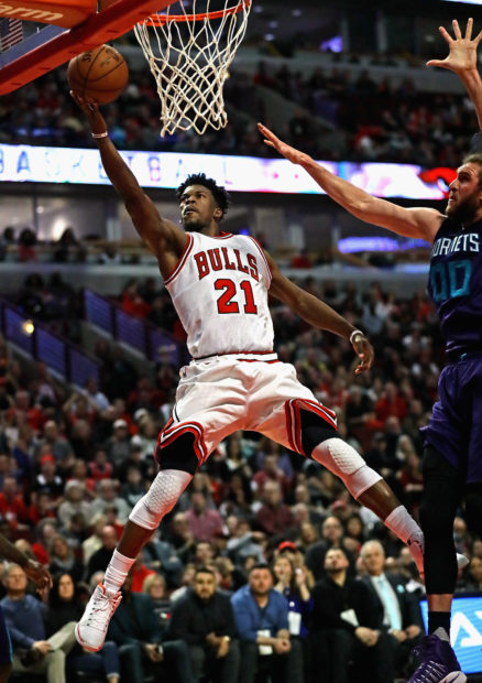 CHICAGO, IL - JANUARY 02: Jimmy Butler #21 of the Chicago Bulls puts up a shot past Spencer Hawes #00 of the Charlotte Hornets on his way to a game-high 52 points at the United Center on January 2, 2017 in Chicago, Illinois. The Bulls defeated the Hornets 118-111. The NOTE TO USER: User expressly acknowledges and agrees that, by downloading and/or using this photograph, user is consenting to the terms and conditions of the Getty Images License Agreement. (Photo by Jonathan Daniel/Getty Images)