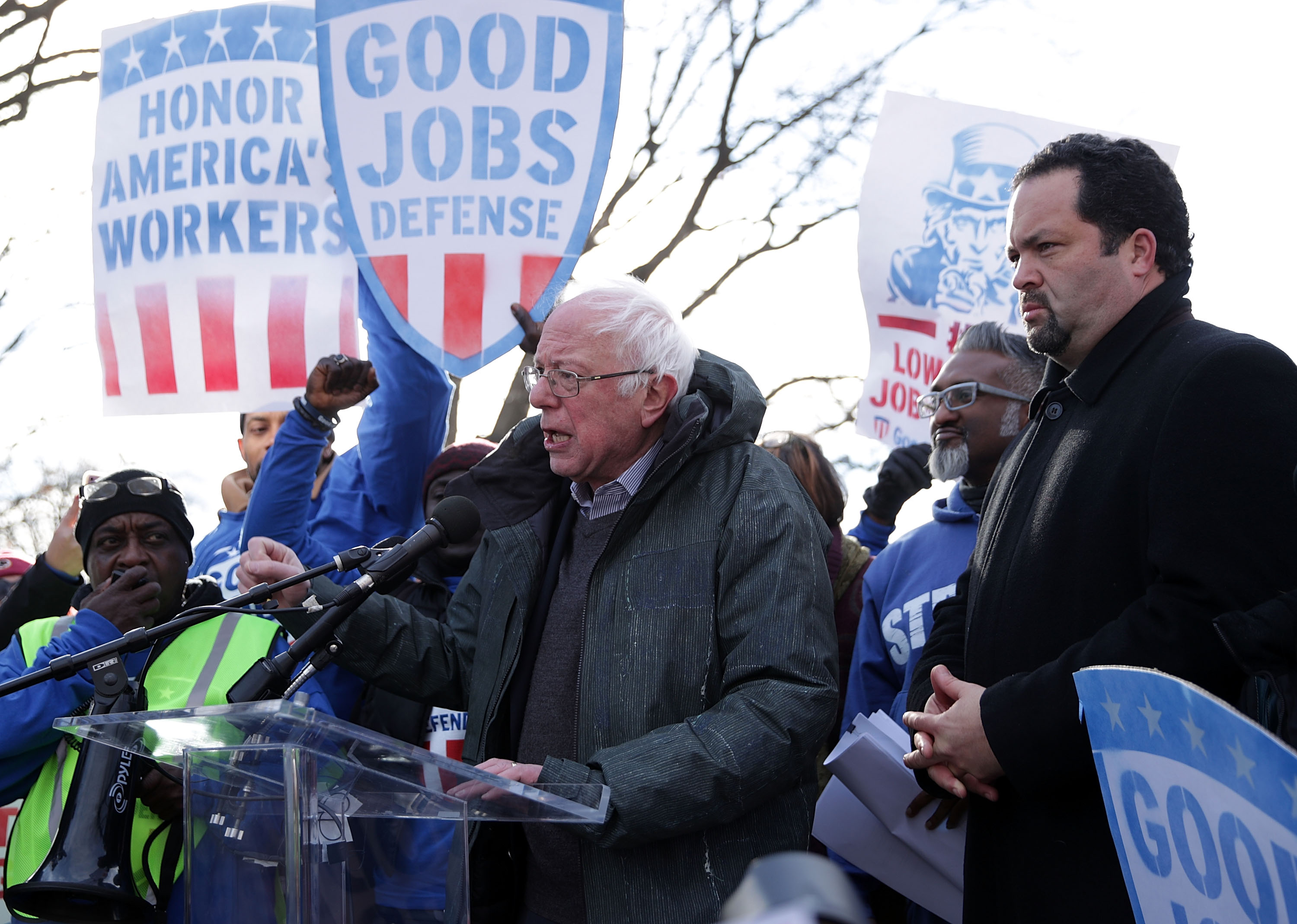 """U.S. Sen. Bernie Sanders (ID-VT) (C) speaks as former president and CEO of NAACP Ben Jealous (R) looks on during a rally """"to fight-back against the Republican war on the working class"""" February 16, 2017 at Upper Senate Park on Capitol Hill in Washington, DC. Alex Wong/Getty Images"""