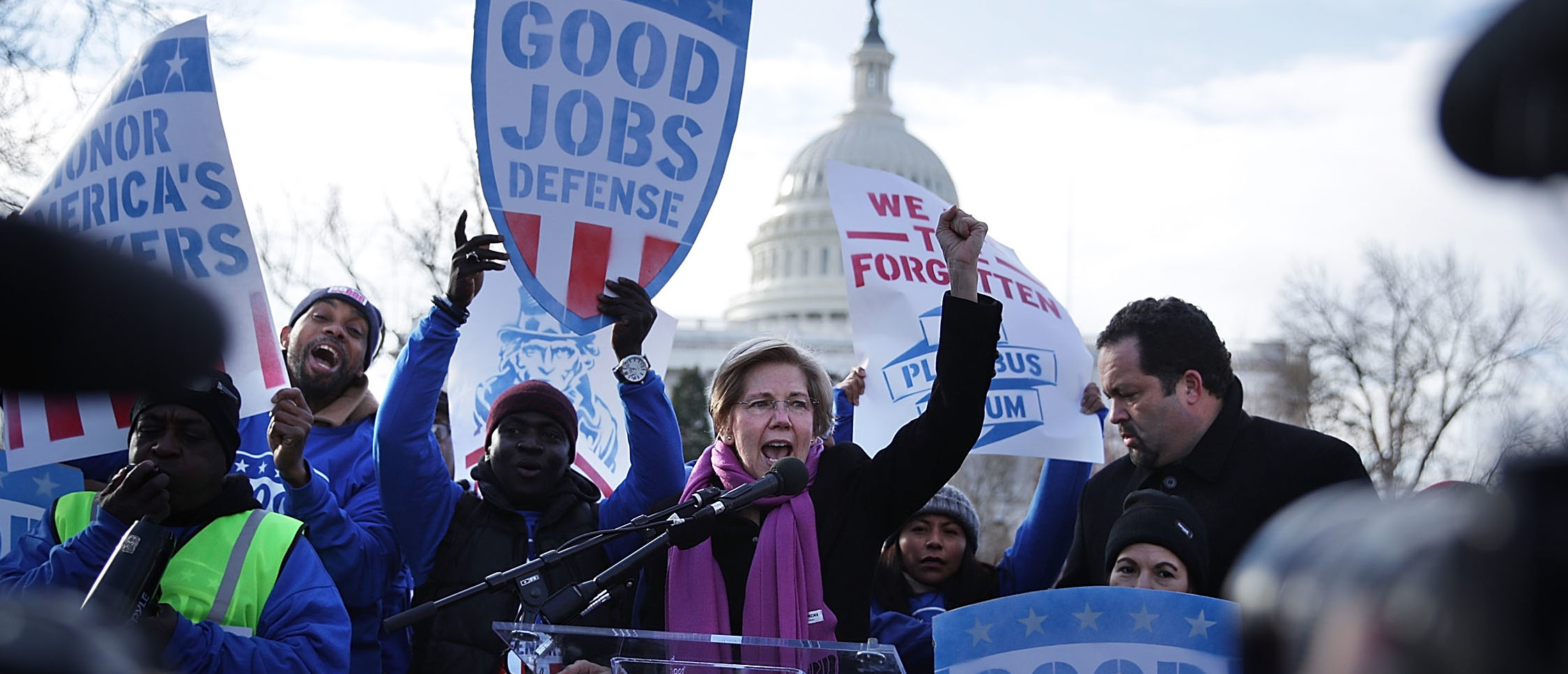 "WASHINGTON, DC - FEBRUARY 16: U.S. Sen. Elizabeth Warren (D-MA) (C) speaks as former president and CEO of NAACP Ben Jealous (R) looks on during a rally ""to fight-back against the Republican war on the working class"" February 16, 2017 at Upper Senate Park on Capitol Hill in Washington, DC. Activists held a rally to celebrate Andrew Puzder's decision to withdraw from consideration to be secretary of labor and Òto hold [President] Trump accountable to the working class."" (Photo by Alex Wong/Getty Images)"