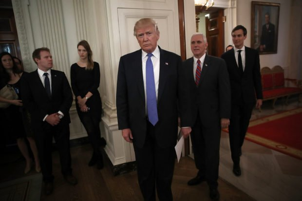 WASHINGTON, DC - FEBRUARY 23: U.S. President Donald Trump (C) waits to be introduced with U.S. Vice President Mike Pence (2nd R) and senior advisor to the President Jared Kushner (R) before Trump participated in a listening session with manufacturing CEOs in the State Dining Room of the White House February 23, 2017 in Washington, DC. Trump met with the CEOs in an effort to develop beneficial new policies on taxes, trade and job creation. Also pictured is Kenneth Frazier (R) CEO of Merck & Company. (Photo by Win McNamee/Getty Images)