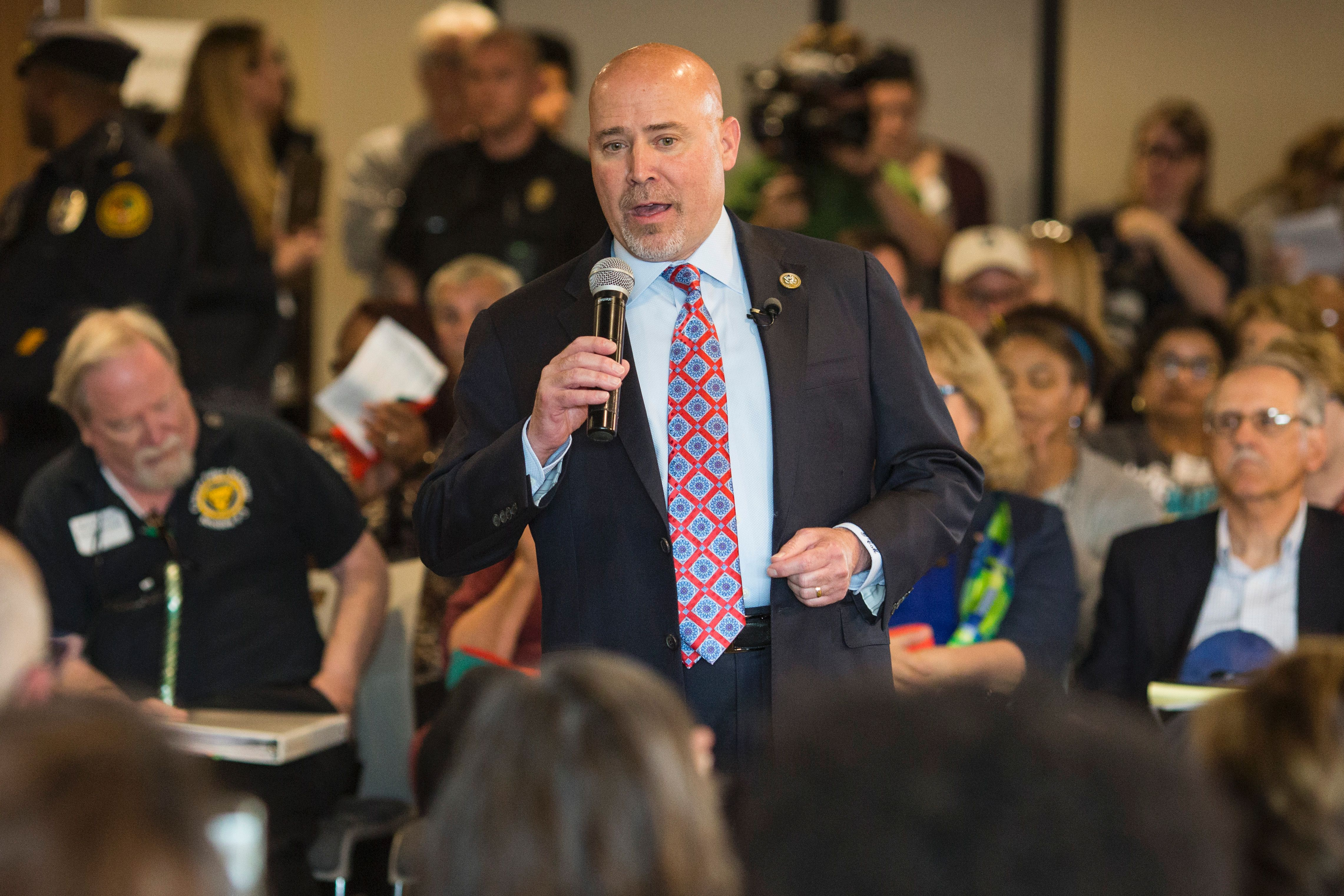 US Representative Tom MacArthur (R-NJ) speaks to constituents during a town hall meeting in Willingboro, New Jersey on May 10, 2017. MacArthur wrote the amendment to the American Health Care Act that revived the failed bill, delivering a legislative victory for US President Donald Trump. DOMINICK REUTER/AFP/Getty Images
