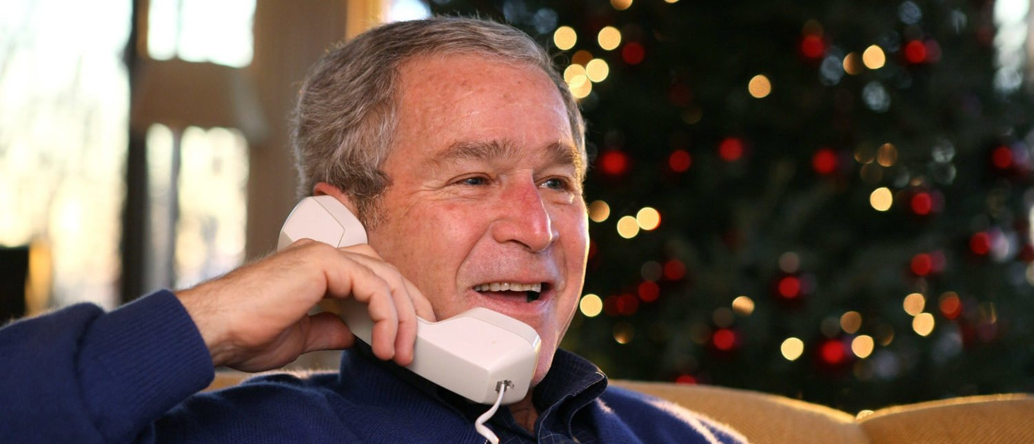 CAMP DAVID, MD - DECEMBER 24: U.S. President George W. Bush makes telephone calls to members of the Armed Forces for Christmas December 24, 2007 at Camp David. Bush made calls to ten U.S. troops serving overseas to thank them for their service. (Photo by Eric Draper/The White House via Getty Images)