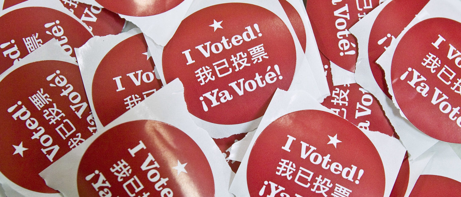 """SAN FRANCISCO - FEBRUARY 5: Stickers that say """"I Voted"""" in English, Spanish and Chinese are seen at a polling place February 5, 2008 in San Francisco, California. Voters in 24 states head to the polls today in the U.S. presidential election's biggest primary day, Super Tuesday. (Photo by David Paul Morris/Getty Images)"""