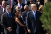 Dina Powell, former Deputy National Security Advisor for Strategy, looks on as President Donald Trump arrives for a group photo with members of the White House National Security Council on the steps of the Eisenhower Executive Office Building on the White House grounds, September 28, 2017 in Washington, DC. Photo by Drew Angerer/Getty Images