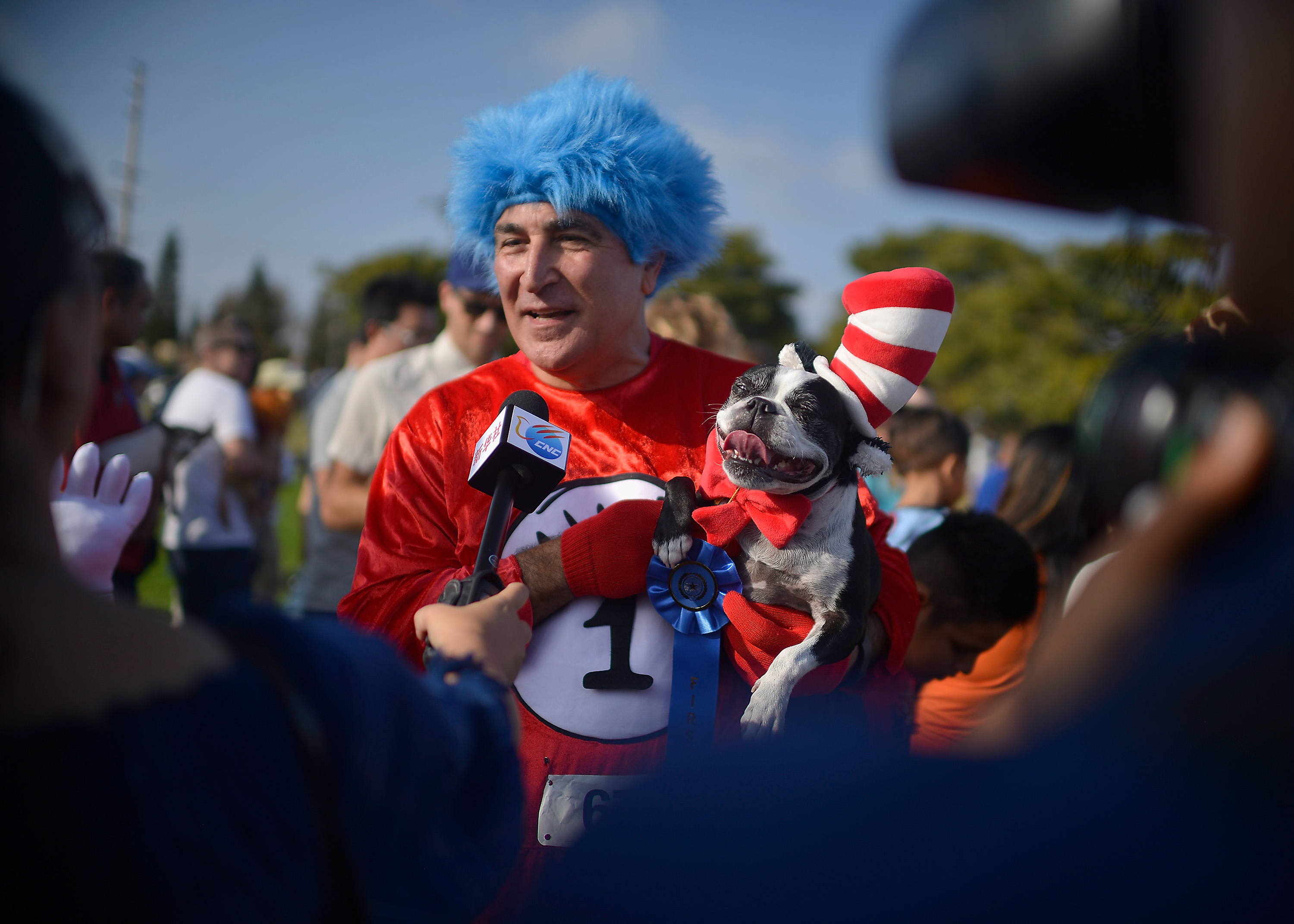 Winners of the parade, Lucy, a boston terrier dressed as Cat in the Hat, and her owner dressed as Thing 1 attends Haute Dog Howl'oween Parade on October 29, 2017 in Long Beach, California. Chelsea Guglielmino/Getty Images