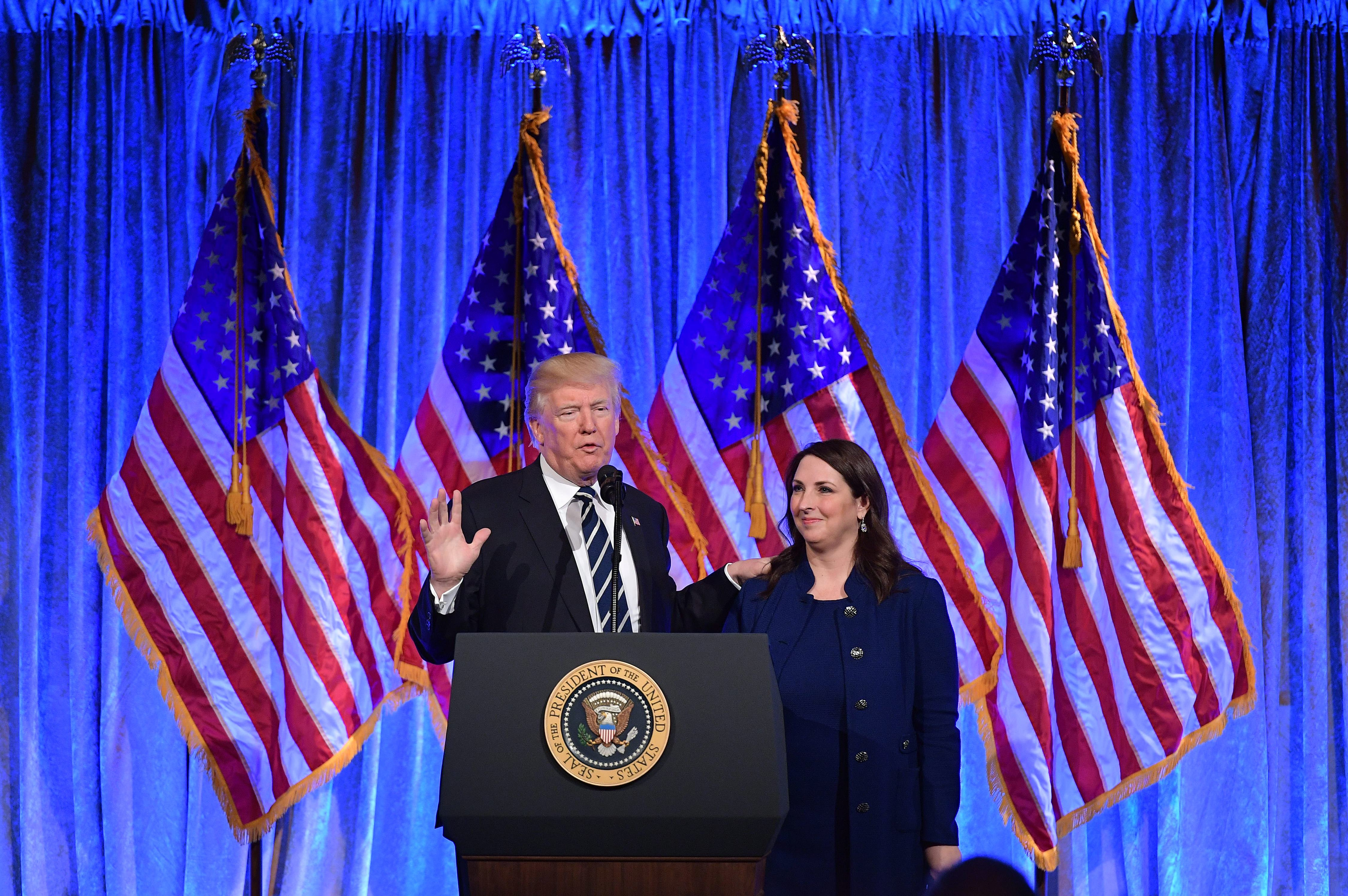 US President Donald Trump speaks after his introduction by RNC Chairwoman Ronna Romney McDaniel at a fundraising breakfast in a restaurant in New York, New York on December 2, 2017. / AFP PHOTO / MANDEL NGAN