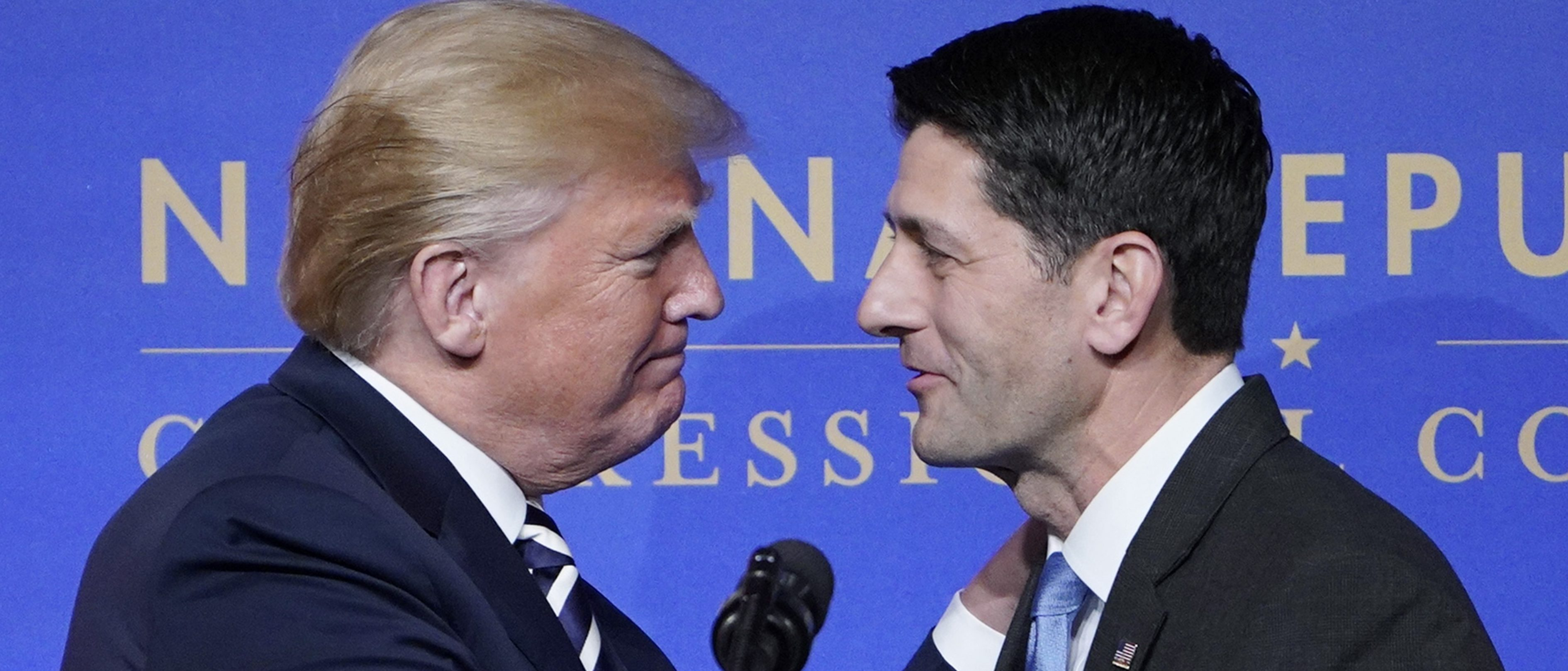 House Speaker Paul Ryan greets US President Donald Trump as he arrives on stage to speak at the National Republican Congressional Committee March Dinner at the National Building Museum on March 20, 2018 in Washington, DC. / AFP PHOTO / MANDEL NGAN