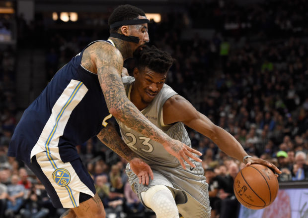 MINNEAPOLIS, MN - APRIL 11: Jimmy Butler #23 of the Minnesota Timberwolves drives to the basket against Wilson Chandler #21 of the Denver Nuggets during the second quarter of the game on April 11, 2018 at the Target Center in Minneapolis, Minnesota. NOTE TO USER: User expressly acknowledges and agrees that, by downloading and or using this Photograph, user is consenting to the terms and conditions of the Getty Images License Agreement. (Photo by Hannah Foslien/Getty Images)