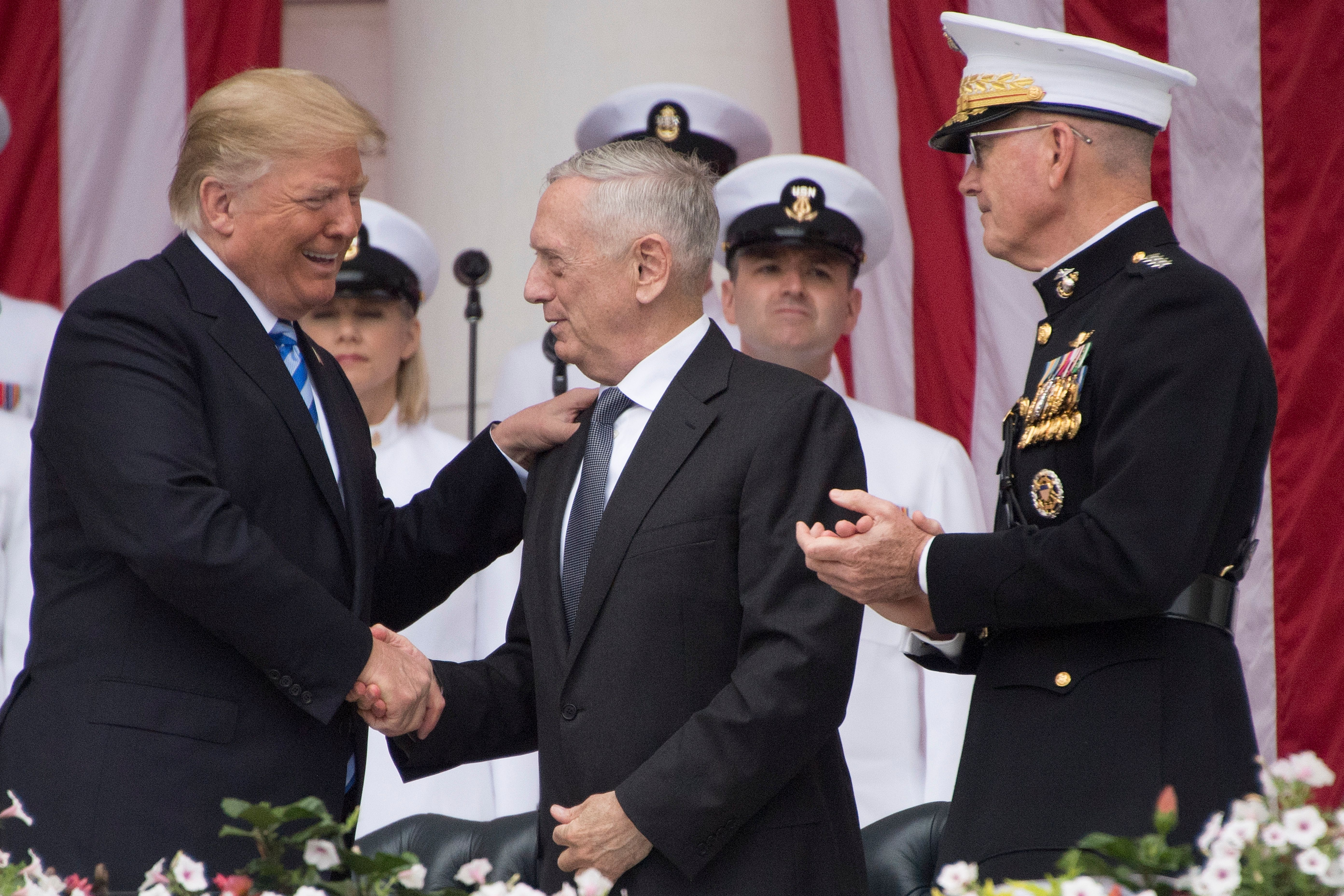 US President Donald Trump (L) greets US Secretary of Defense James Mattis (C) and Chairman of the Joint Chiefs of Staff General Joseph Dunford (R) before speaking at a Memorial Day ceremony at Arlington National Cemetery in Arlington, Virginia, on May 28, 2018. (Photo by JIM WATSON / AFP) (Photo credit should read JIM WATSON/AFP/Getty Images)