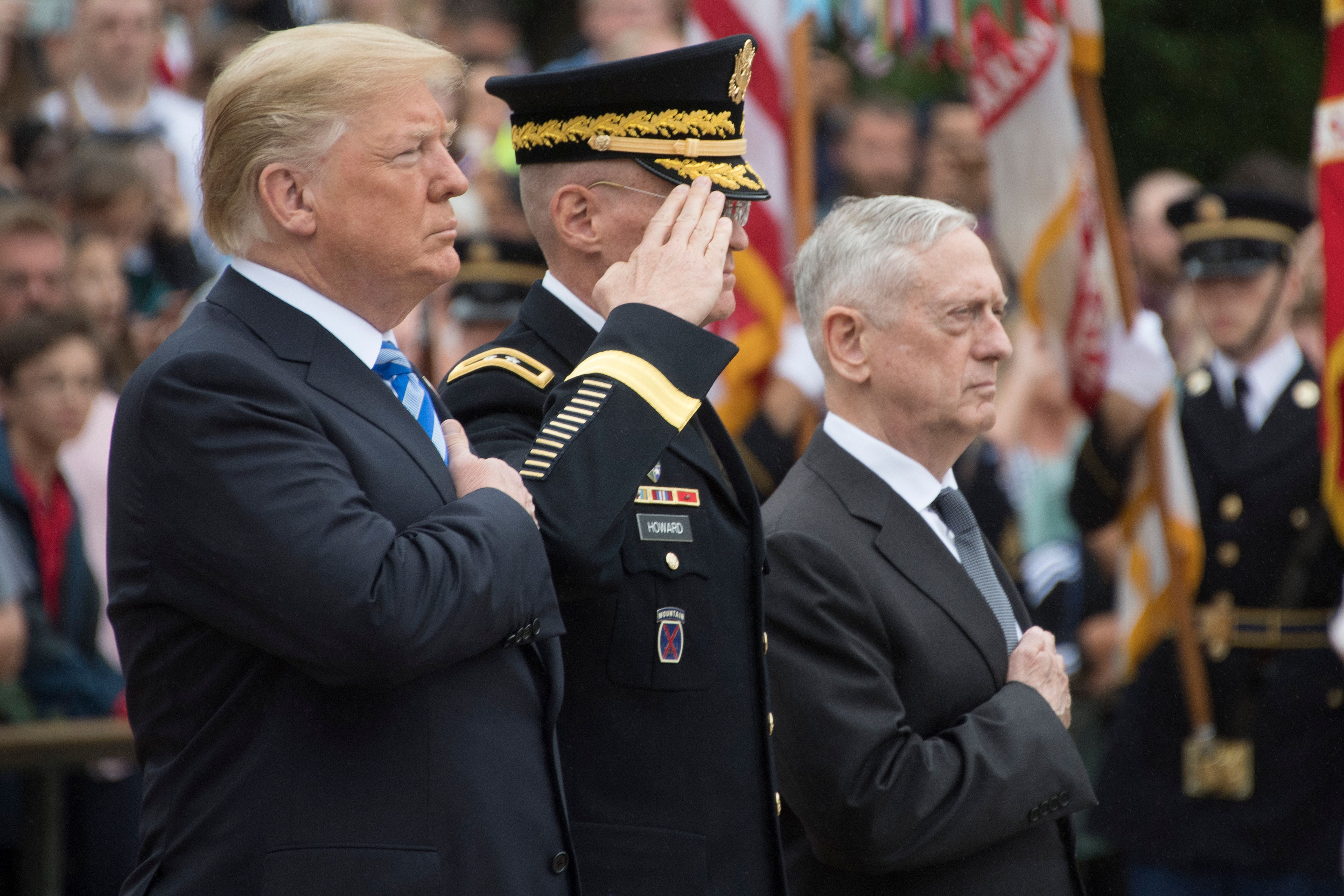 US President Donald Trump (L) and Defense Secretary Jim Mattis (3rd L) mark Memorial Day by laying a wreath at the Tomb of the Unknown Soldier at Arlington National Cemetery in Arlington, Virginia, on May 28, 2018. JIM WATSON/AFP/Getty Images