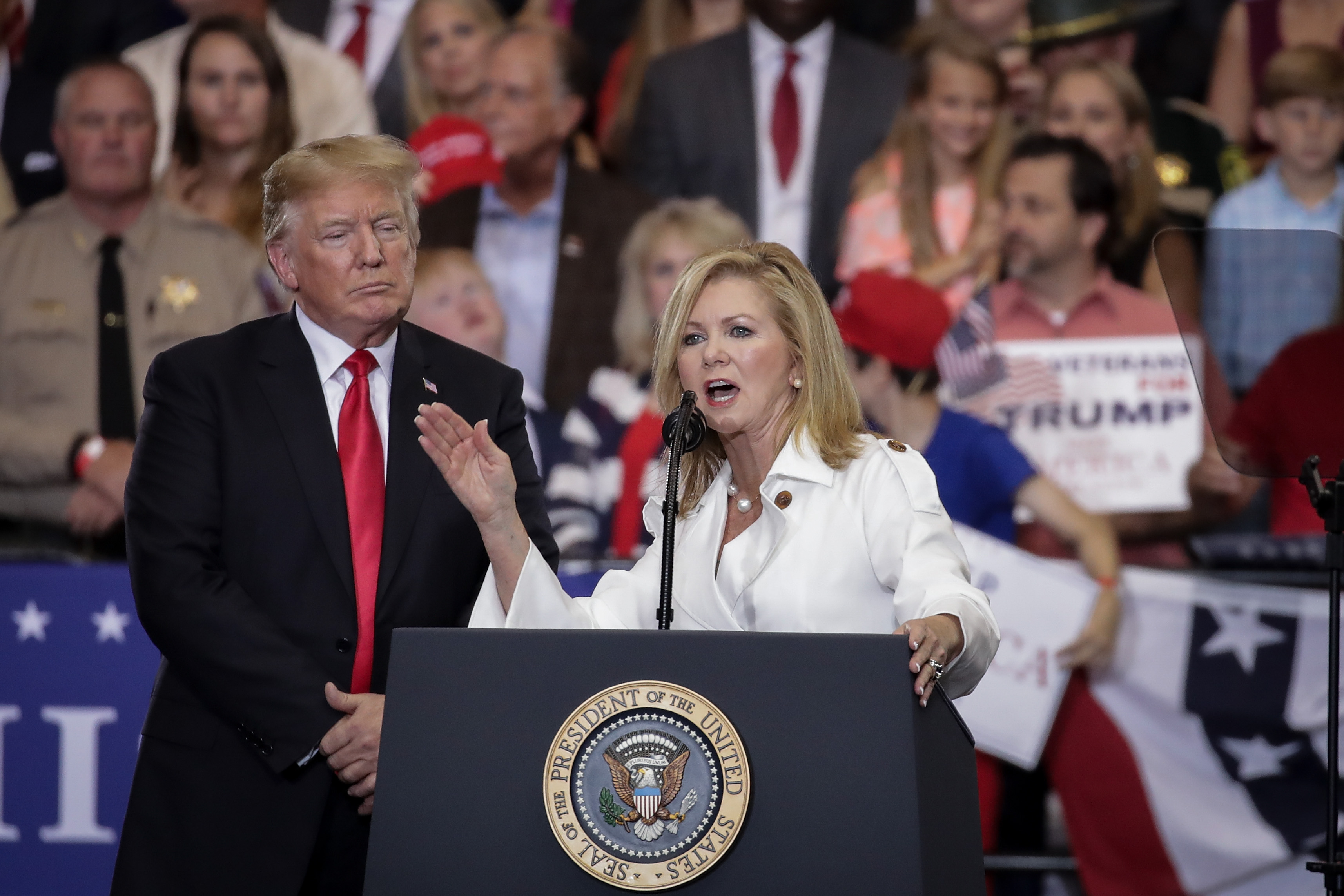 NASHVILLE, TN - MAY 29: (L to R) U.S. President Donald Trump looks on Rep. Marsha Blackburn (R-TN), who is running for U.S. Senate, speaks during a rally at the Nashville Municipal Auditorium, May 29, 2018 in Nashville, Tennessee. Earlier in the day, President Trump held a fundraising event in support Blackburn, who is running against two-term former Tennessee Gov. Phil Bredesen, a Democrat. They are competing for the Senate seat currently held by Sen. Bob Corker (R-TN), who declined to run for a third term. Recent polling indicates a close race between Blackburn and Bredesen. (Photo by Drew Angerer/Getty Images)