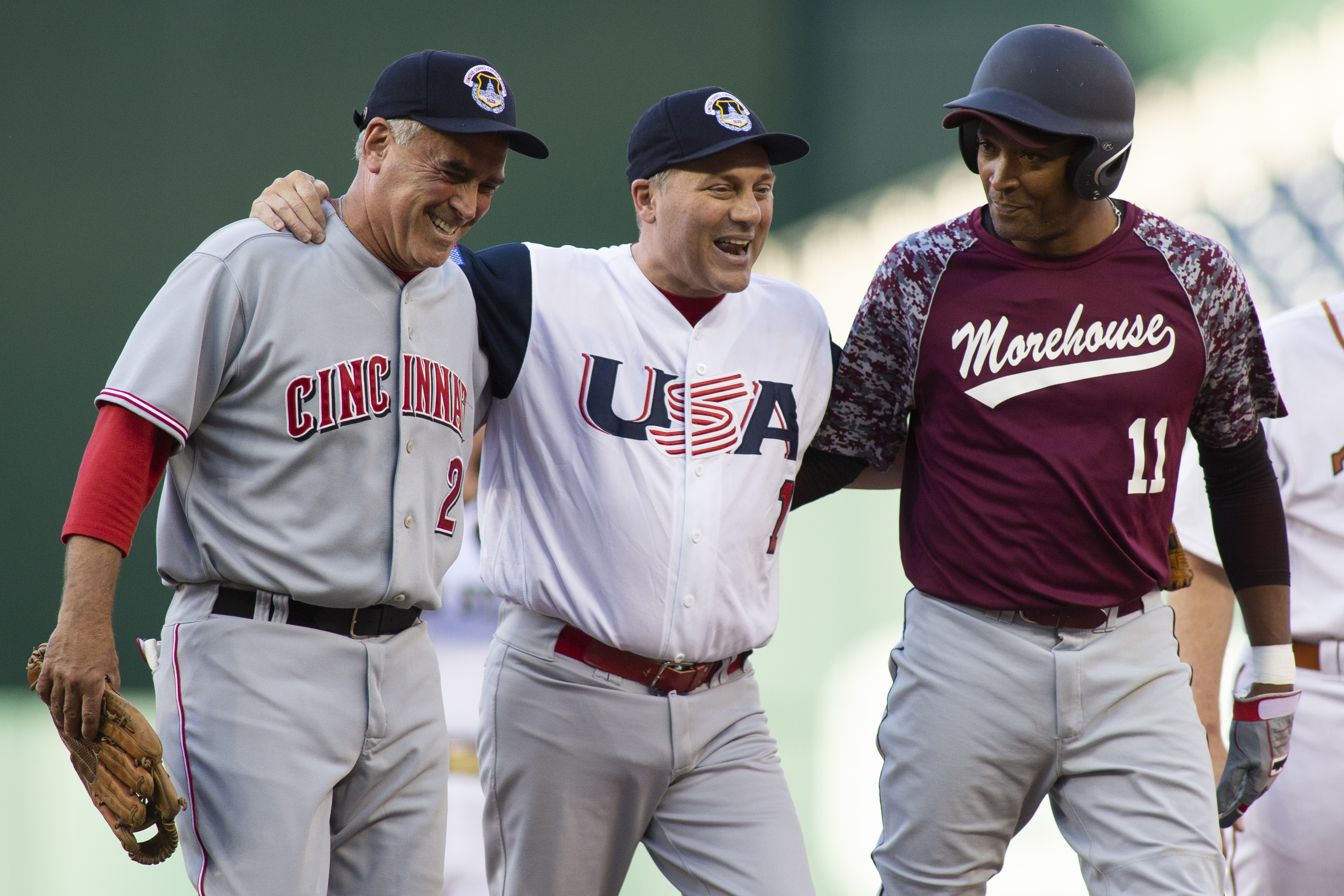 Rep Steve Scalise (R-LA) (C) is helped off the field by Rep Cedric Richmond (D-LA) (R) and Rep Bran Wenstroup (R-OH) (L) after playing second base during the Congressional Baseball Game on June 14, 2018 in Washington, DC. Alex Edelman/Getty Images