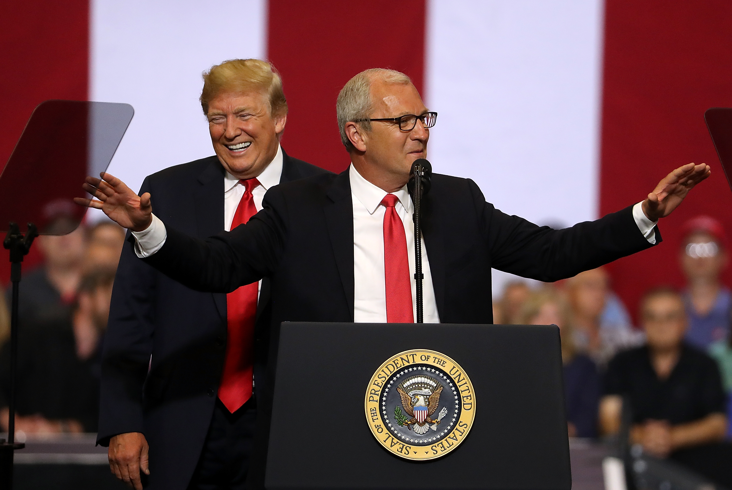 """FARGO, ND - JUNE 27: U.S. president Donald Trump (L) looks on as U.S. Rep. Kevin Cramer (R-ND) speaks to supporters during a campaign rally at Scheels Arena on June 27, 2018 in Fargo, North Dakota. President Trump held a campaign style """"Make America Great Again"""" rally in Fargo, North Dakota with thousands in attendance. (Photo by Justin Sullivan/Getty Images)"""