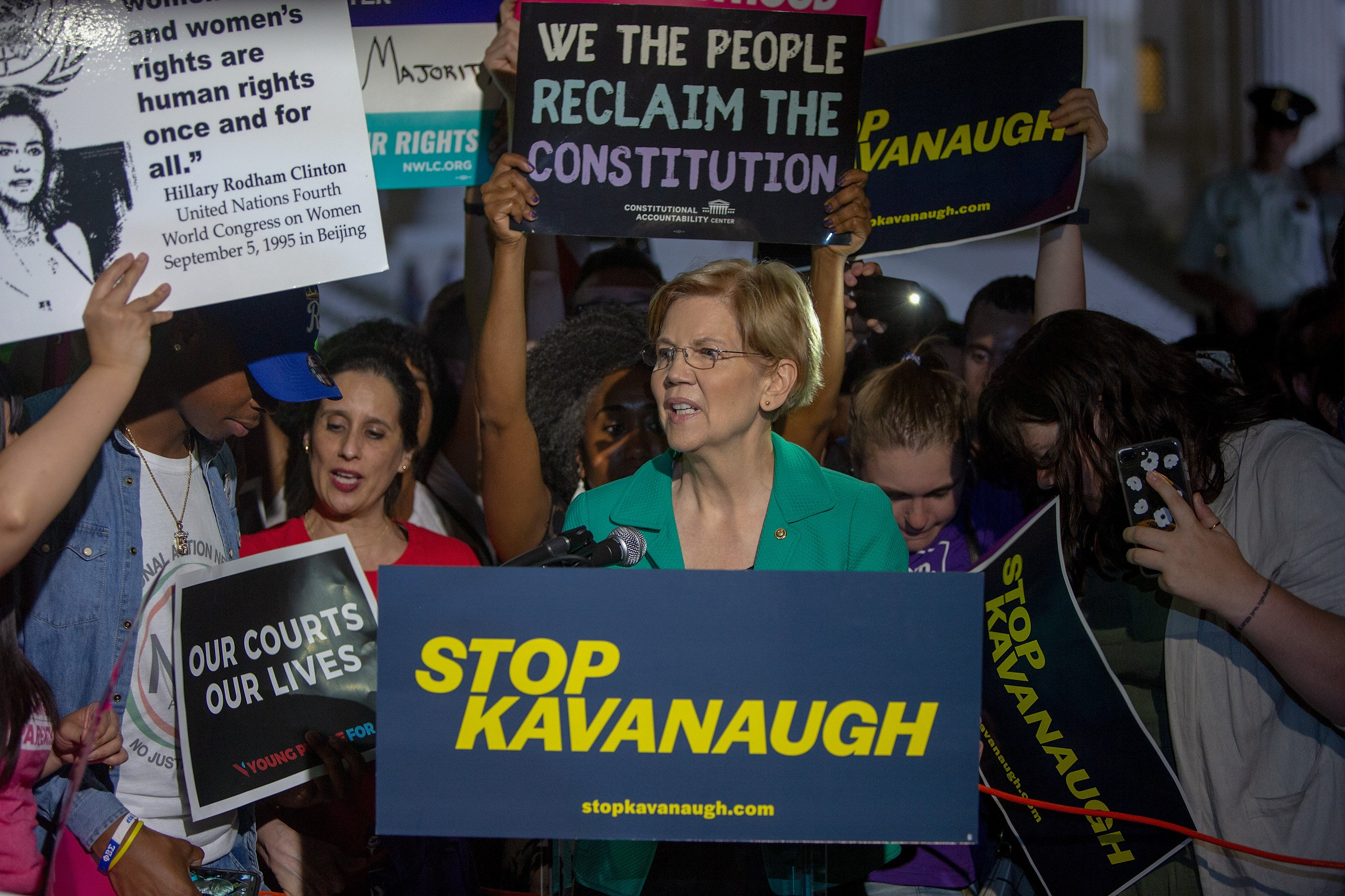 Senator Elizabeth Warren (D-MA) speaks to protesters in front of the U.S. Supreme Court on July 9, 2018 in Washington, DC. Tasos Katopodis/Getty Images