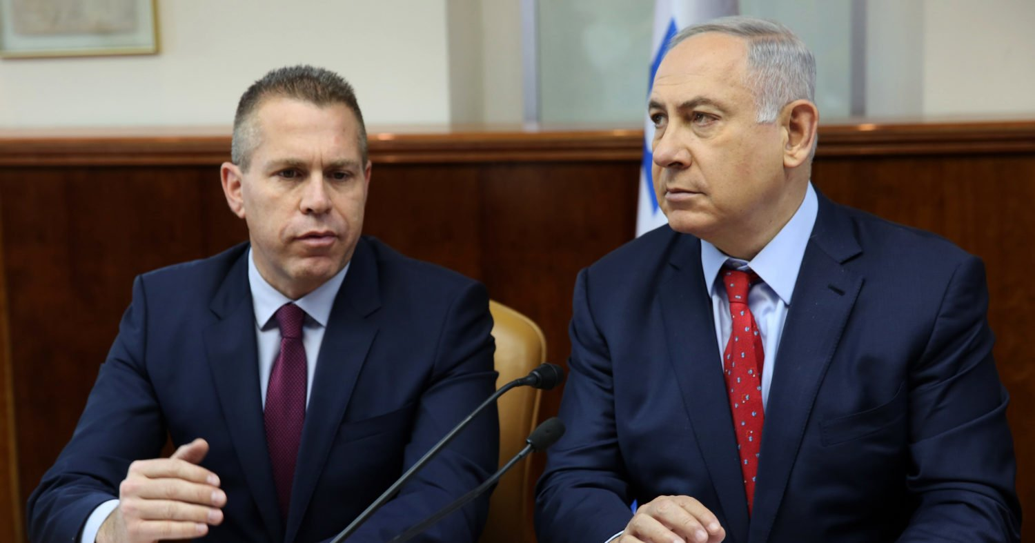 Israeli Prime Minister Benjamin Netanyahu (R) sits next to Israeli Public security Minister Gilad Erdan during the weekly cabinet meeting at his Jerusalem's office on April 10, 2016. (GALI TIBBON/AFP/Getty Images)