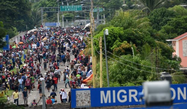 Honduran migrants taking part in a caravan heading to the US, arrive at the border crossing point with Mexico, in Ciudad Tecun Uman, Guatemala on October 19, 2018. - (Photo by ORLANDO SIERRA / AFP / Getty Images)