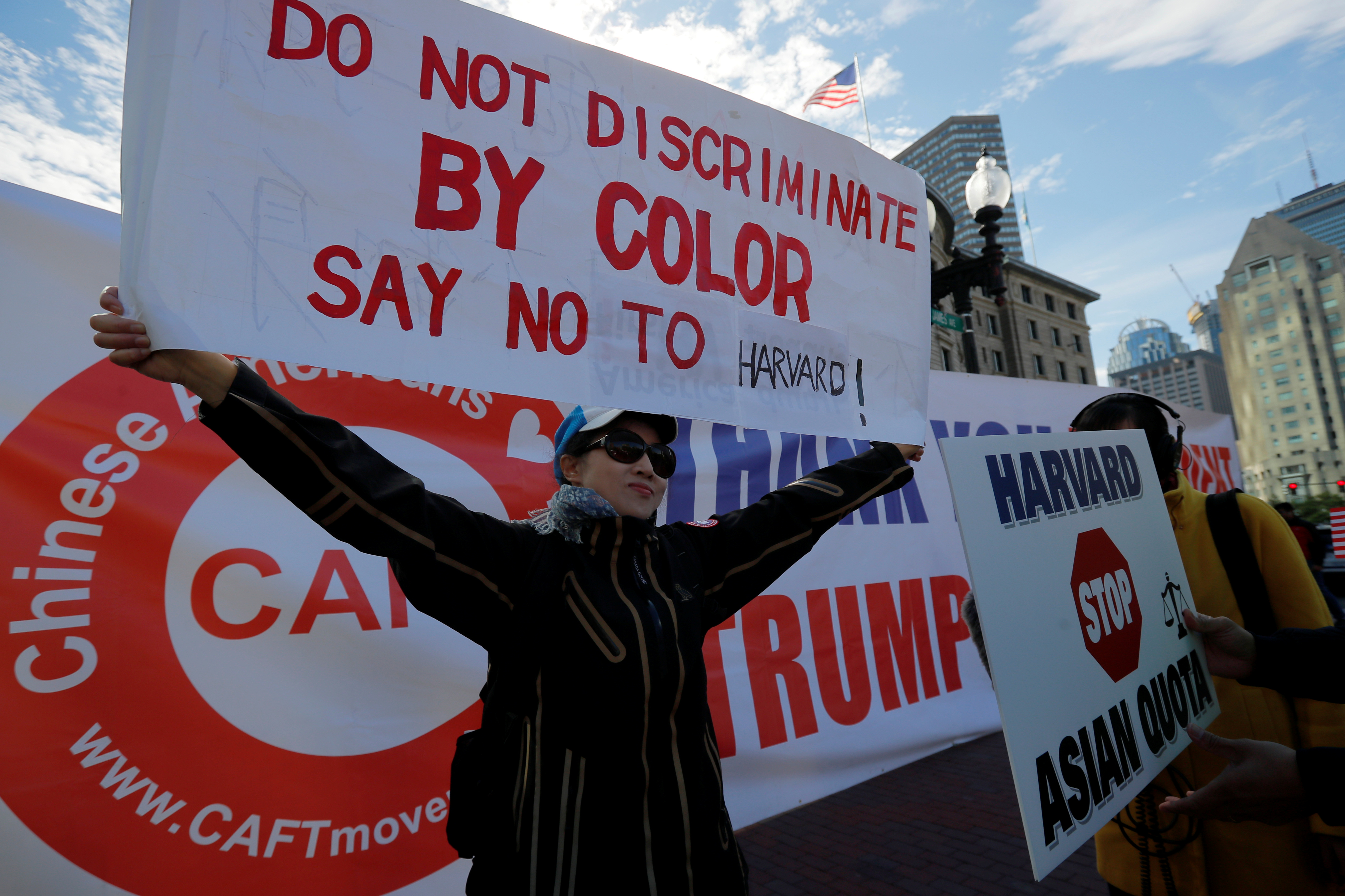 "Different groups of supporters attend the ""Rally for the American Dream - Equal Education Rights for All,"" ahead of the start of the trial in a lawsuit accusing Harvard University of discriminating against Asian-American applicants, in Boston, Massachusetts, U.S., October 14, 2018. REUTERS/Brian Snyder"
