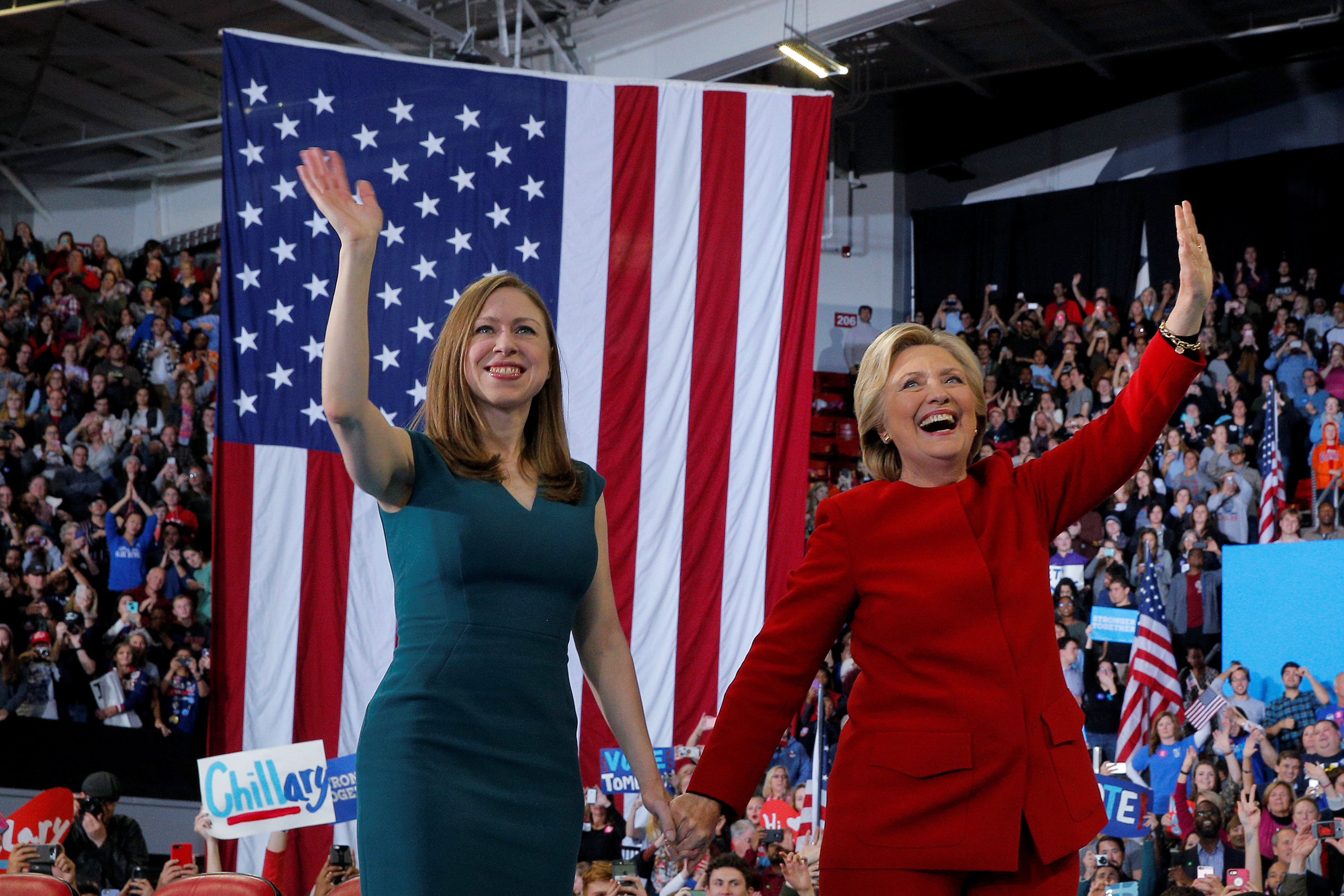 U.S. Democratic presidential nominee Hillary Clinton and her daughter Chelsea wave to the crowd at a campaign rally in Raleigh, North Carolina, U.S. Nov. 8, 2016. REUTERS/Brian Snyder