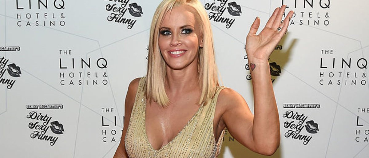 """Actress/comedian Jenny McCarthy waves as she arrives at The LINQ to promote her """"Dirty Sexy Funny"""" comedy show on September 25, 2014 in Las Vegas, Nevada. The tour will kick off on September 26 at The Quad Resort Casino in Las Vegas. (Photo by Ethan Miller/Getty Images)"""