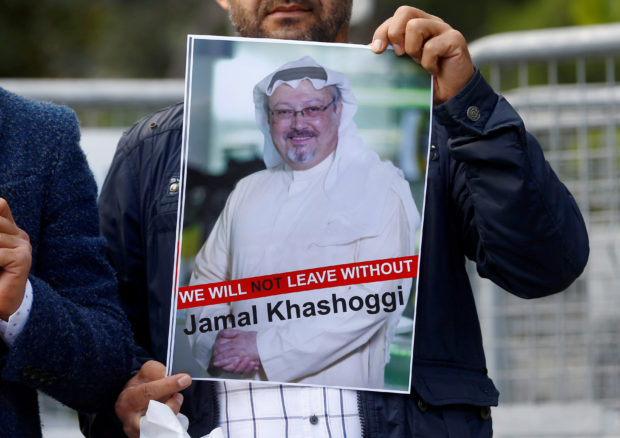 FILE PHOTO: A demonstrator holds picture of Saudi journalist Jamal Khashoggi during a protest in front of Saudi Arabia's consulate in Istanbul, Turkey, October 5, 2018. REUTERS/Osman Orsal