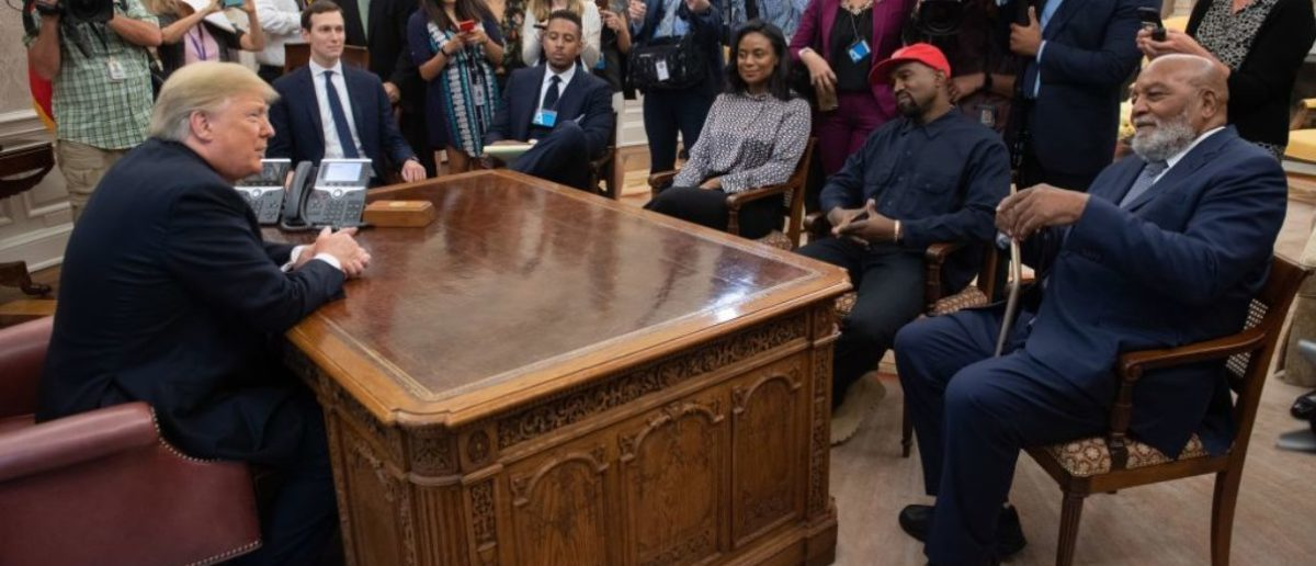 US President Donald Trump meets with rapper Kanye West and former football player Jim Brown (R) in the Oval Office of the White House in Washington, DC, October 11, 2018. (Photo credit: SAUL LOEB/AFP/Getty Images)