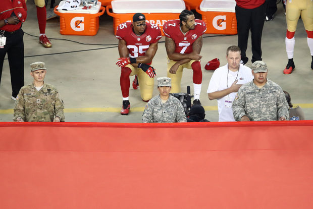SANTA CLARA, CA - SEPTEMBER 12: Colin Kaepernick #7 and Eric Reid #35 of the San Francisco 49ers kneel in protest during the national anthem prior to playing the Los Angeles Rams. (Photo by Ezra Shaw/Getty Images)