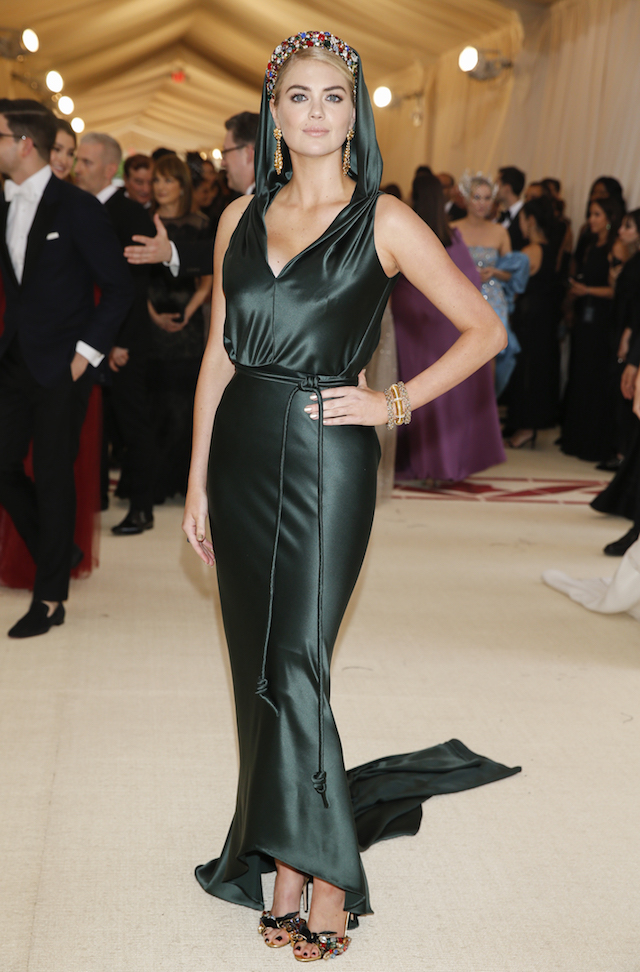 Model Kate Upton arrives at the Metropolitan Museum of Art Costume Institute Gala (Met Gala) to celebrate the opening of ìHeavenly Bodies: Fashion and the Catholic Imaginationî in the Manhattan borough of New York, U.S., May 7, 2018. REUTERS/Carlo Allegri