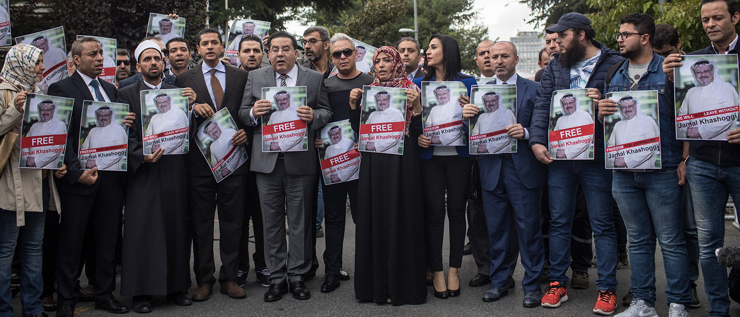 Nobel Prize winner Tawakkol Karman (10th-L) holds a poster of Saudi journalist Jamal Khashoggi during a protest outside Saudi Arabia's consulate on October 8, 2018 in Istanbul, Turkey. Fears are growing over the fate of missing journalist Jamal Khashoggi after Turkish officials said they believe he was murdered inside the Saudi consulate. Saudi consulate officials have said that missing writer and Saudi critic Jamal Khashoggi went missing after leaving the consulate, however the statement directly contradicts other sources including Turkish officials. Jamal Khashoggi a Saudi writer critical of the Kingdom and a contributor to the Washington Post was living in self-imposed exile in the U.S. (Photo by Chris McGrath/Getty Images)