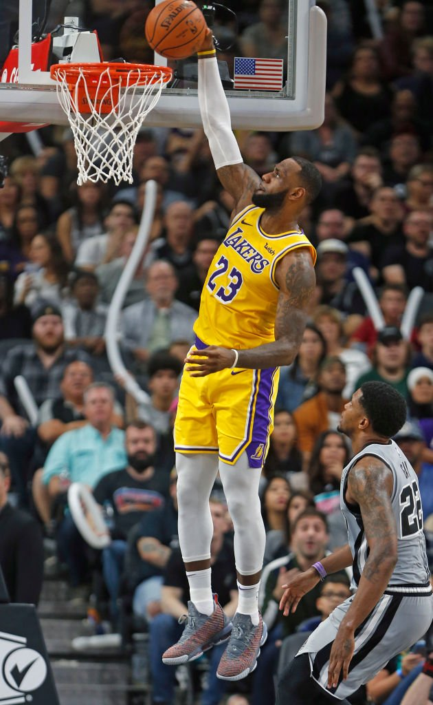 SAN ANTONIO,TX - OCTOBER 27: LeBron James #23 of the Los Angeles Lakers dunks past Rudy Gay #22 of the San Antonio Spurs at AT&T Center on October 27 , 2018 in San Antonio, Texas. (Ronald Cortes/Getty Images)