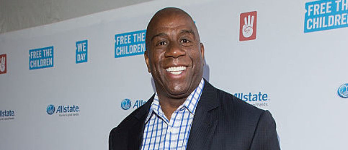 """CHICAGO, IL - APRIL 30: NBA legend, two-time Hall-of-Famer, entrepreneur and philanthropist, Earvin """"Magic"""" Johnson walks the We Day Red Carpet at We Day Illinois 2015 at Allstate Arena on April 30, 2015 in Chicago, Illinois. (Photo by Jeff Schear/Getty Images for We Day)."""