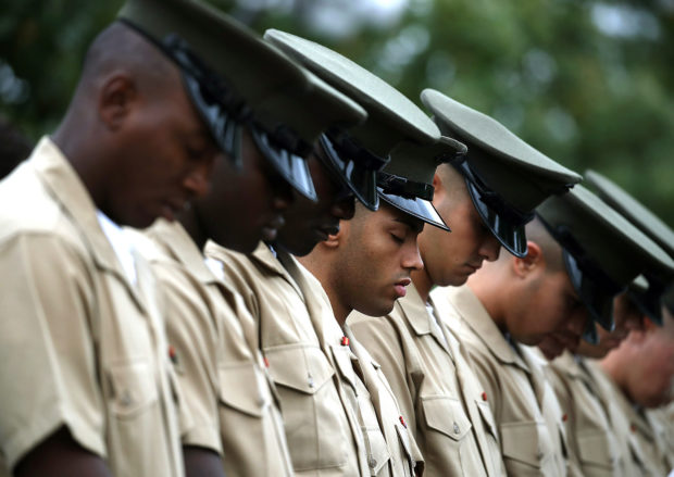 U.S. Marines bow their heads during a ceremony to commemorate the anniversary of the 1983 bombing of the Marine barracks in Beirut, Lebanon, at the Marine barracks on October 23, 2017 in Washington, DC. 34 years ago today terrorist detonated two truck bombs at a building that housed U.S. troops, killing 220 Marines, 18 sailors and 3 soldiers. (Photo by Mark Wilson/Getty Images)