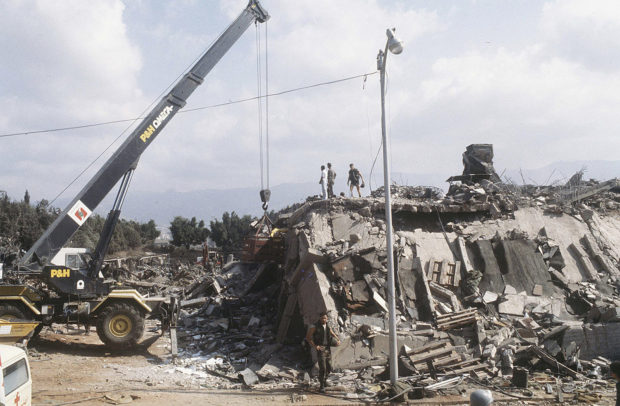 A crane is brought in after the explosion of the Marine Corps building in Beirut, Lebanon October 23, 1983. The U.S. Supreme Court on Wednesday ruled that almost $2 billion in frozen Iranian assets must be turned over to American families of people killed in the 1983 bombing of a U.S. Marine Corps barracks in Beirut and other attacks blamed on Iran. REUTERS/US Marines/Handout via REUTERS