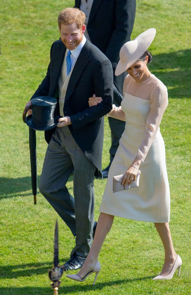 Britain's Prince Harry, Duke of Sussex and his new wife Britain's Meghan, Duchess of Sussex, attend the Prince of Wales's 70th Birthday Garden Party at Buckingham Palace in London on May 22, 2018. - The Prince of Wales and The Duchess of Cornwall hosted a Garden Party to celebrate the work of The Prince's Charities in the year of Prince Charles's 70th Birthday. (Photo credit: IAN VOGLER/AFP/Getty Images)