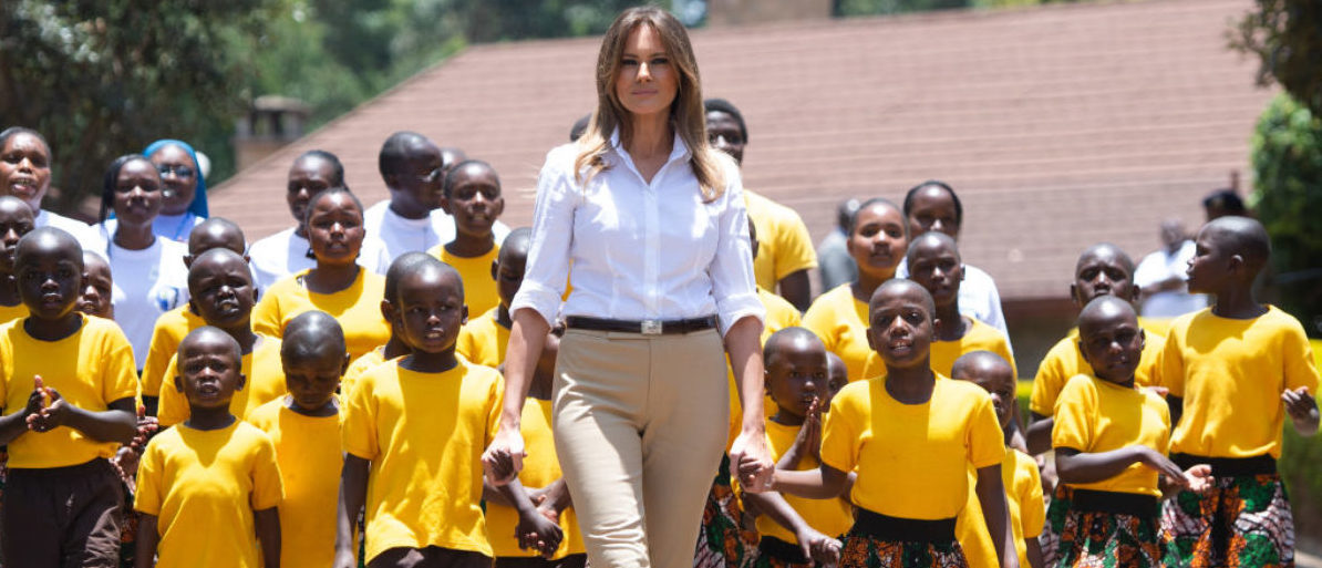 US First Lady Melania Trump walks with children as she visits the Nest Childrens Home Orphanage, which primarily cares for children who's parents have been incarcerated, in Nairobi on October 5, 2018, during the third leg of a solo tour of Africa. (Photo by SAUL LOEB / AFP) (Photo credit should read SAUL LOEB/AFP/Getty Images)