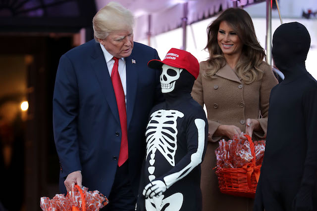 U.S. President Donald Trump (L) and first lady Melania Trump host Halloween at the White House on the South Lawn October 30, 2017 in Washington, DC. The first couple gave cookies away to costumed trick-or-treaters one day before the Halloween holiday. (Photo by Chip Somodevilla/Getty Images)