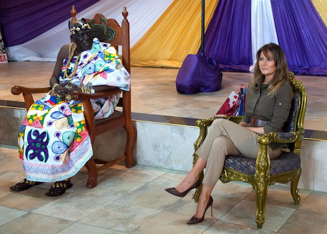 US First Lady Melania Trump sits alongside Osabarimba Kwesi Atta II, the chieftan of the regional Fante tribe (L), at the Emintsimadze palace in Cape Coast, Ghana, October 3, 2018. - US First Lady Melania Trump is on a solo tour of Africa to promote her children's welfare programme. (Photo credit: SAUL LOEB/AFP/Getty Images)