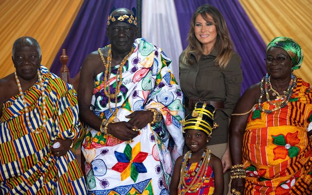 US First Lady Melania Trump poses with Osabarimba Kwesi Atta II, the chieftan of the regional Fante tribe (2ndL), at the Emintsimadze palace in Cape Coast, Ghana, October 3, 2018. - US First Lady Melania Trump is on a solo tour of Africa to promote her children's welfare programme. (Photo credit: SAUL LOEB/AFP/Getty Images)